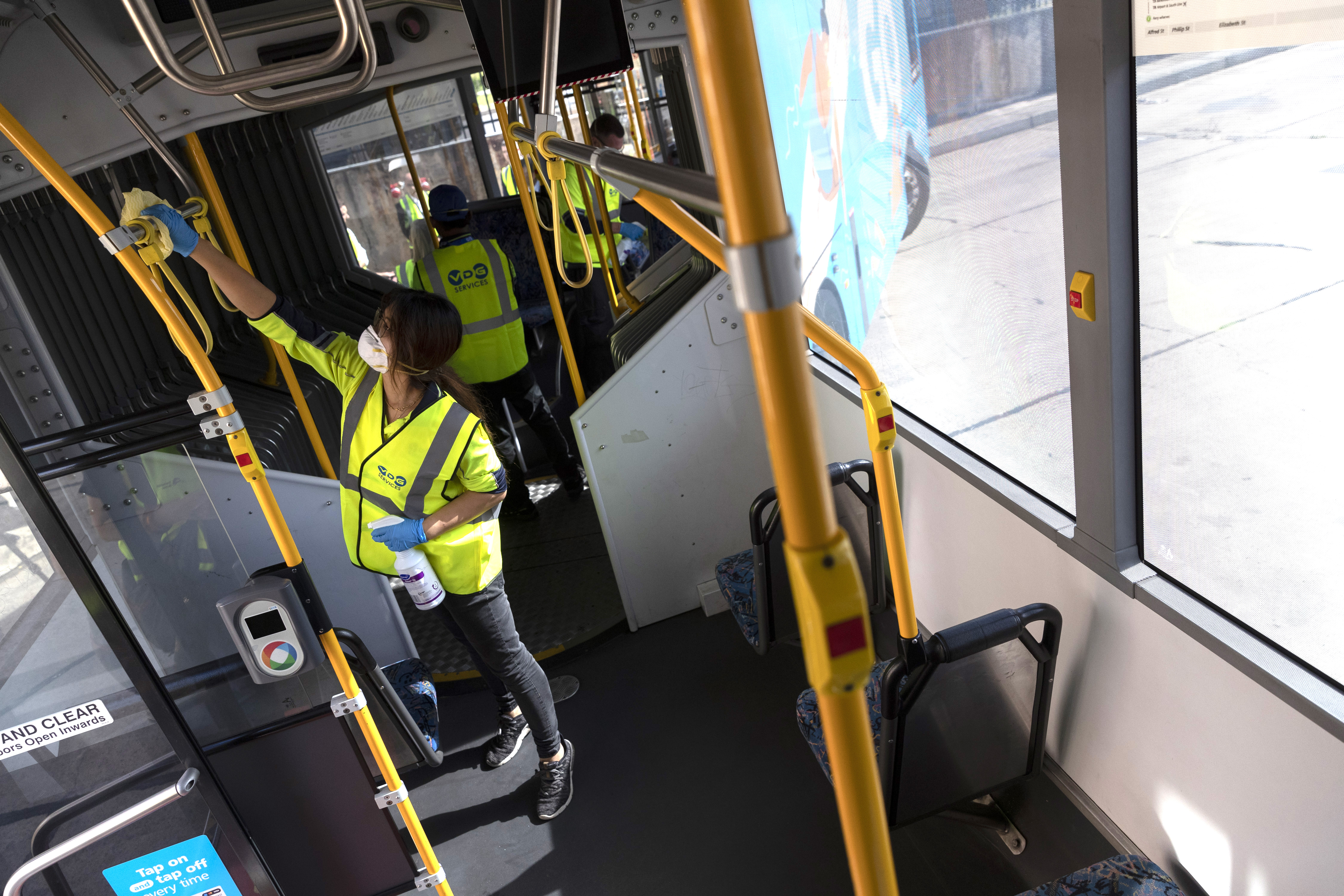 A cleaner at work at the Waverley Bus Depot in Sydney. NSW Treasurer Dominic Perrottet said the equivalent of 3000 full-time cleaners would be working by the end of June in an effort to help combat COVID-19 in New South Wales