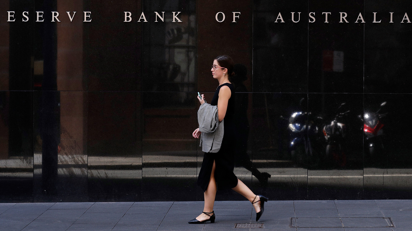 A woman walks past the Reserve Bank of Australia in Sydney. Last week Australia's central bank cut its benchmark interest rate by a quarter of a percentage point to a record low 0.25%, urgently seeking to alleviate economic shocks from the new coronavirus.