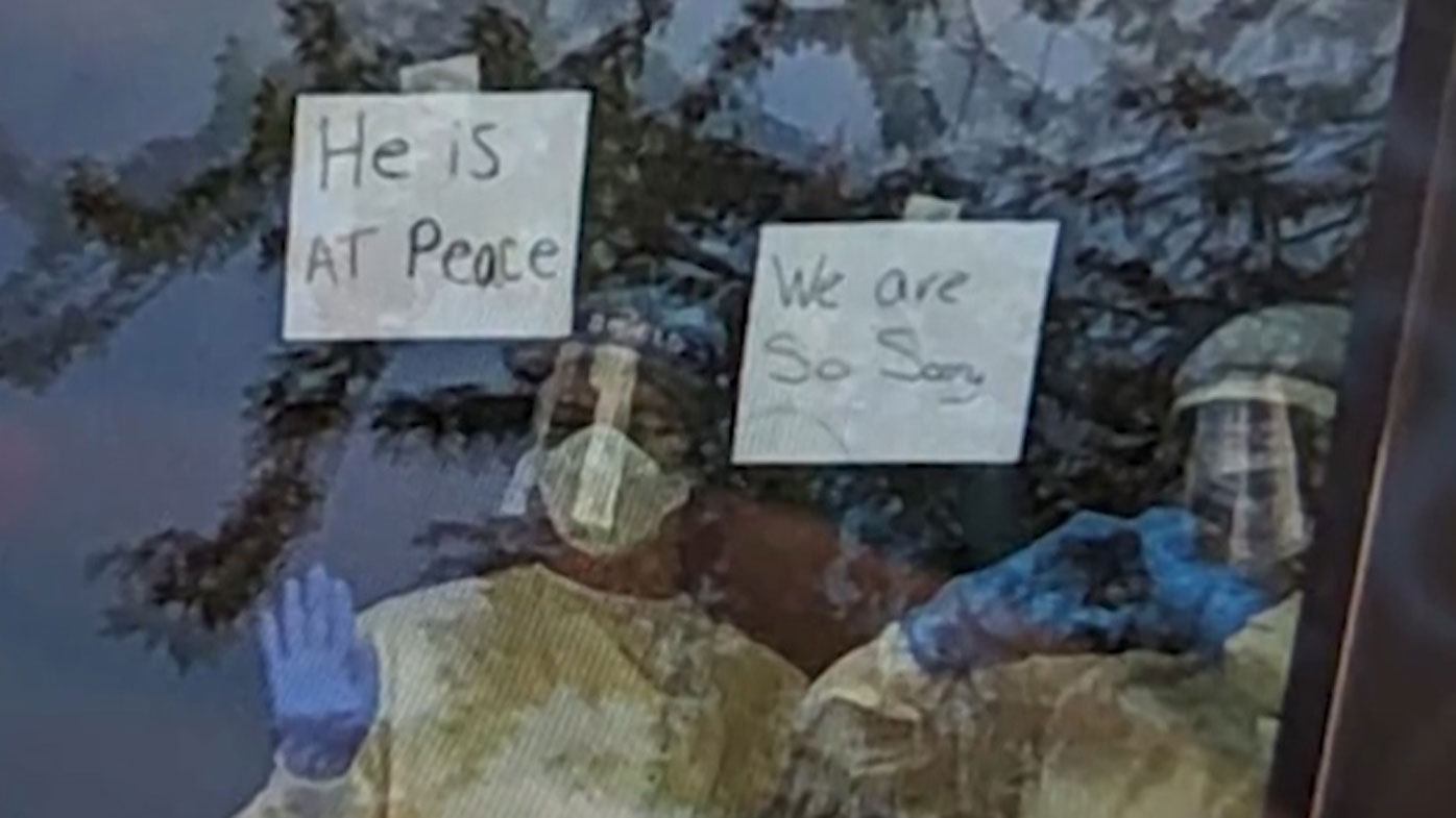 Nurses hold notes up to window to tell family about father's coronavirus death