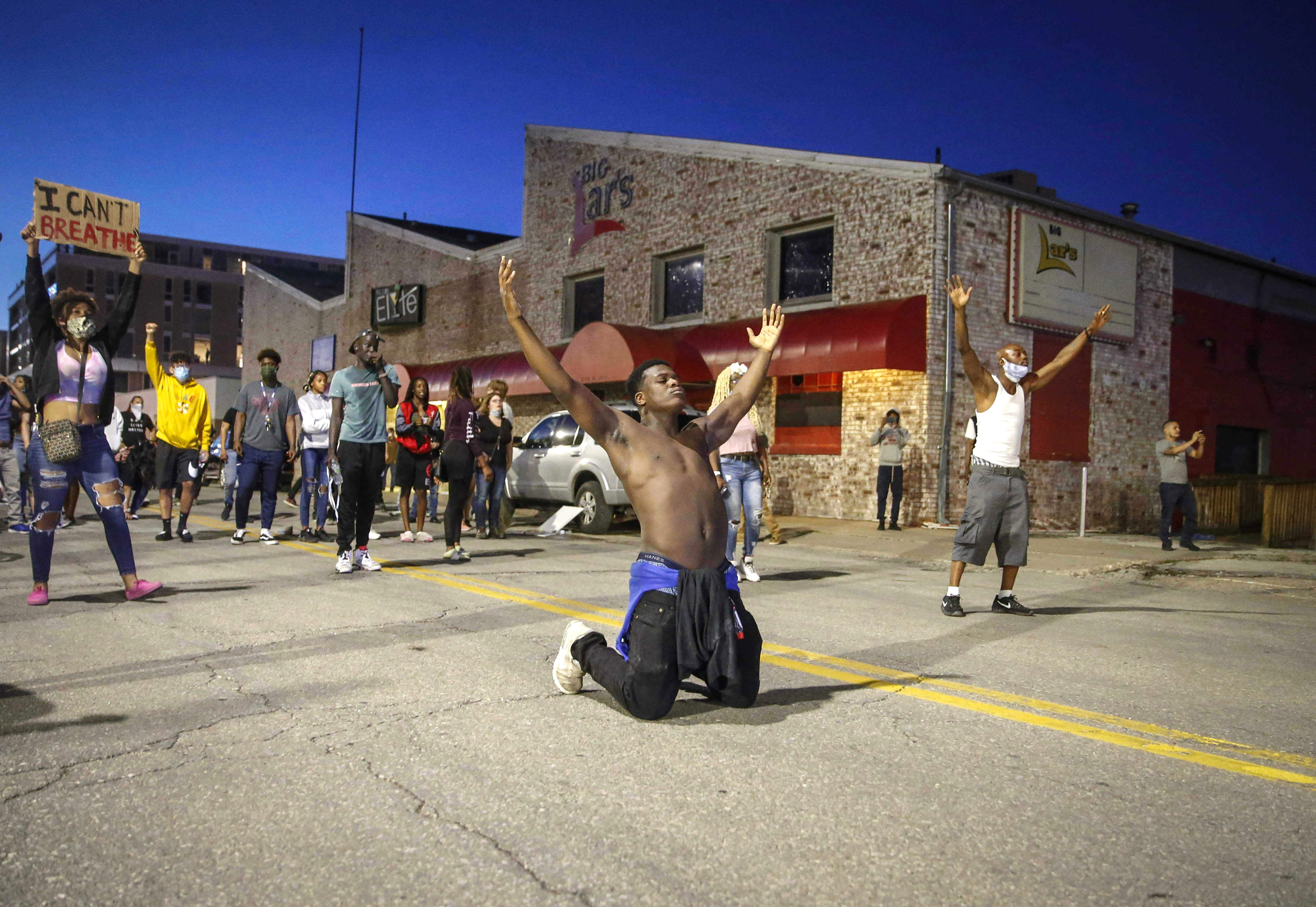 In this May 29 photo, Marcus Lavon of Des Moines, Iowa. raises his hands during a protest in Des Moines. Protests have been erupting all over the country after George Floyd died earlier this week in police custody in Minneapolis.