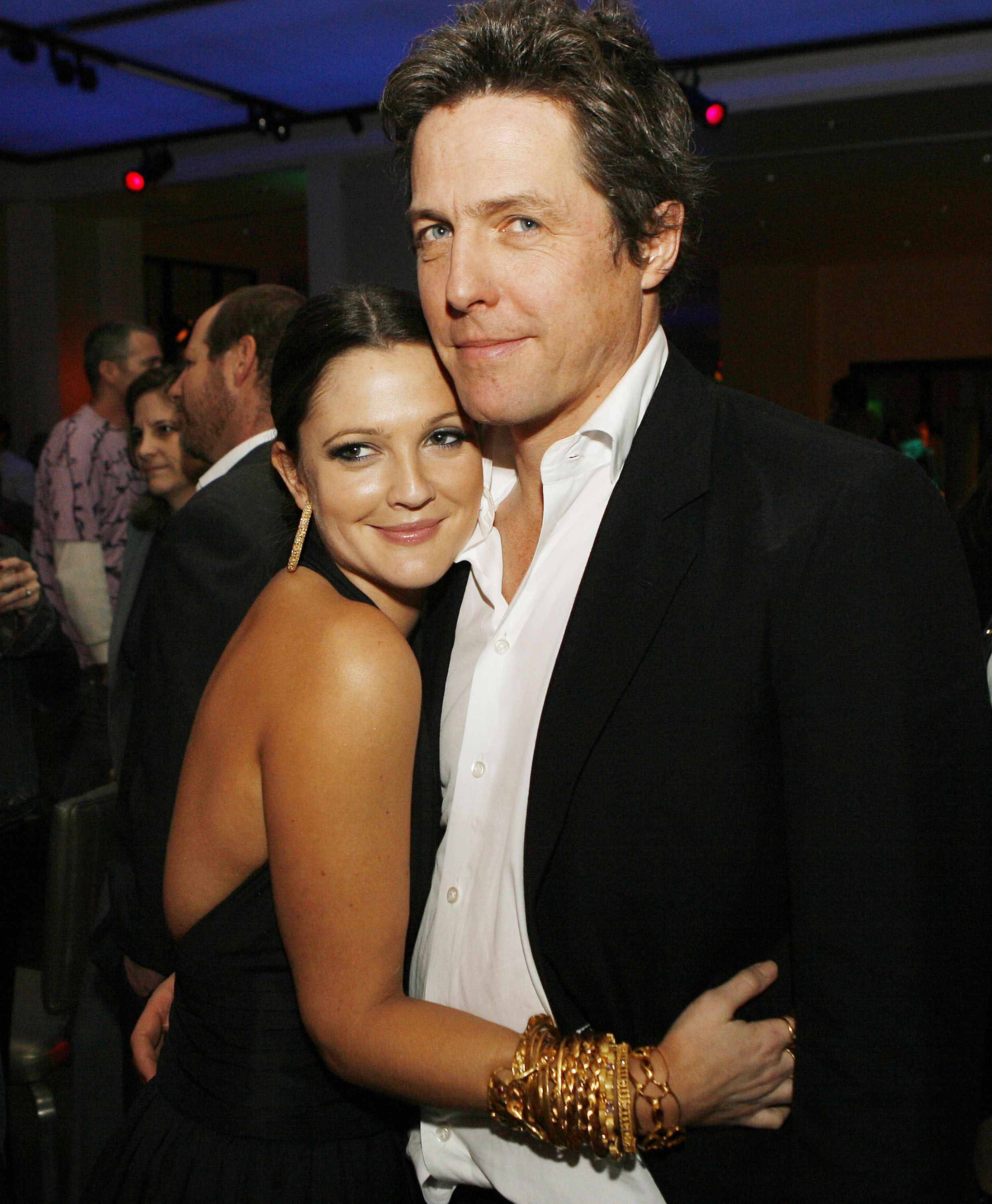 """Actors Drew Barrymore and Hugh Grant pose at the afterparty for the premiere of Warner Bros. Picture's """"Music and Lyrics"""" at the Annix on February 7, 2007 in Los Angeles, California."""