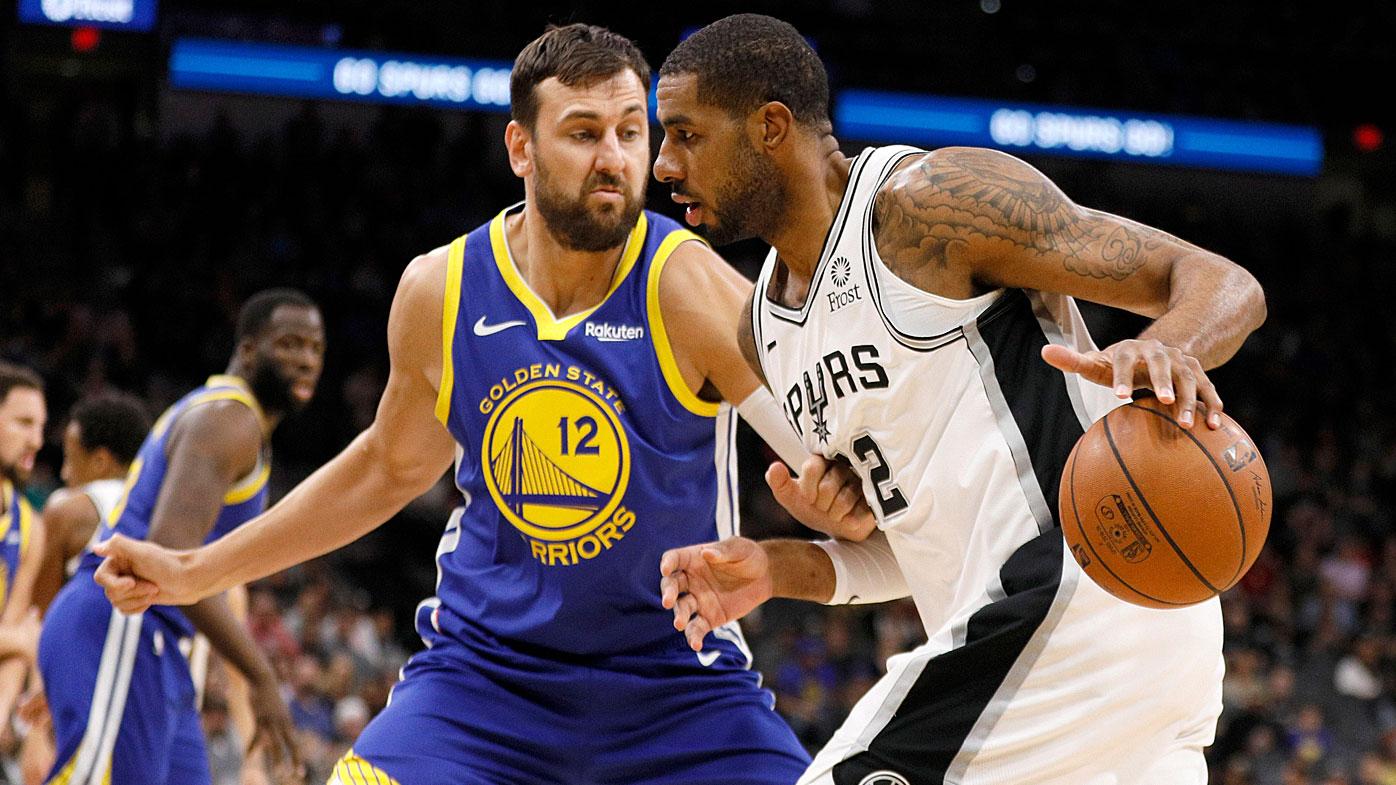 Spurs power forward LaMarcus Aldridge (12) dribbles the ball as Golden State Warriors center Andrew Bogut