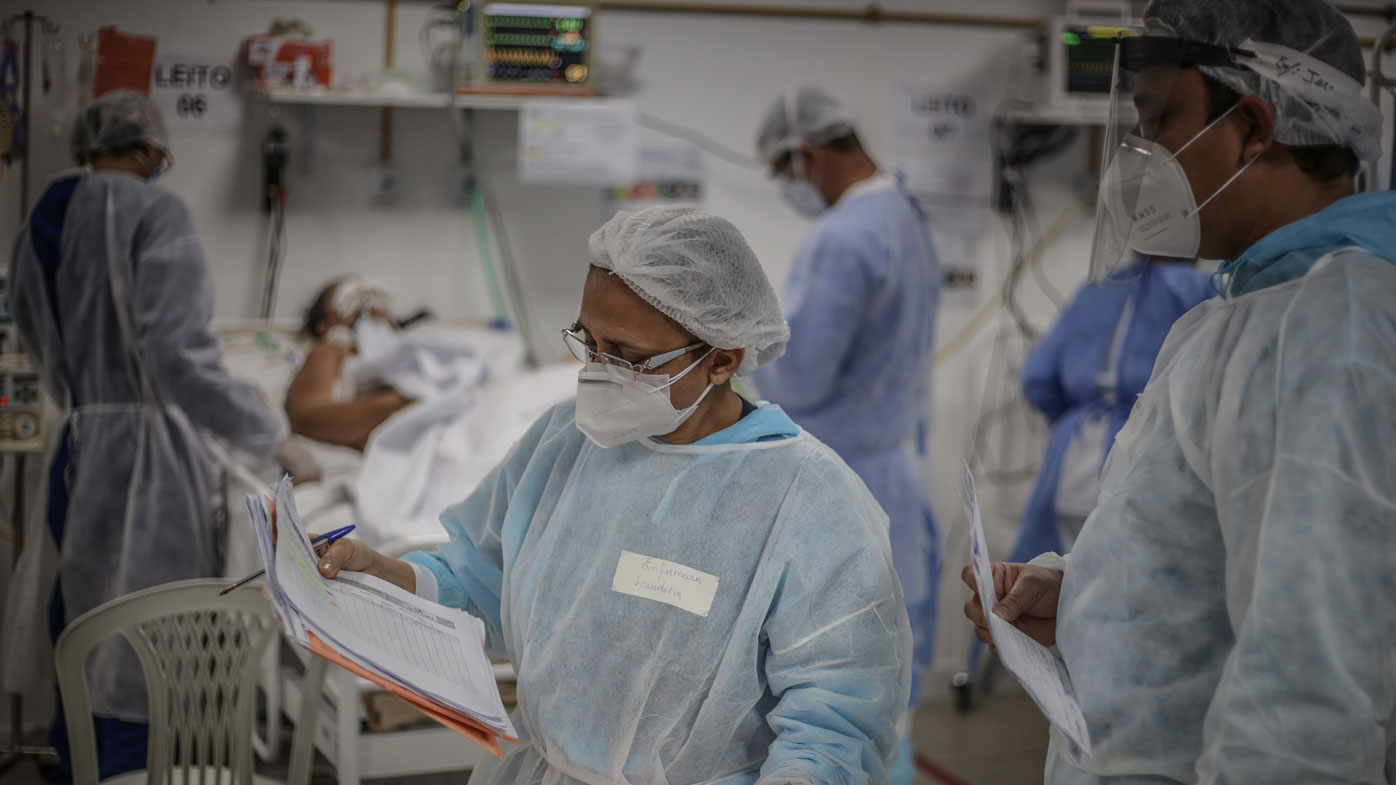A chief nurse checks patient reports at the Intensive Treatment Unit at the Gilberto Novaes Municipal Field Hospital in Manaus, Brazil.