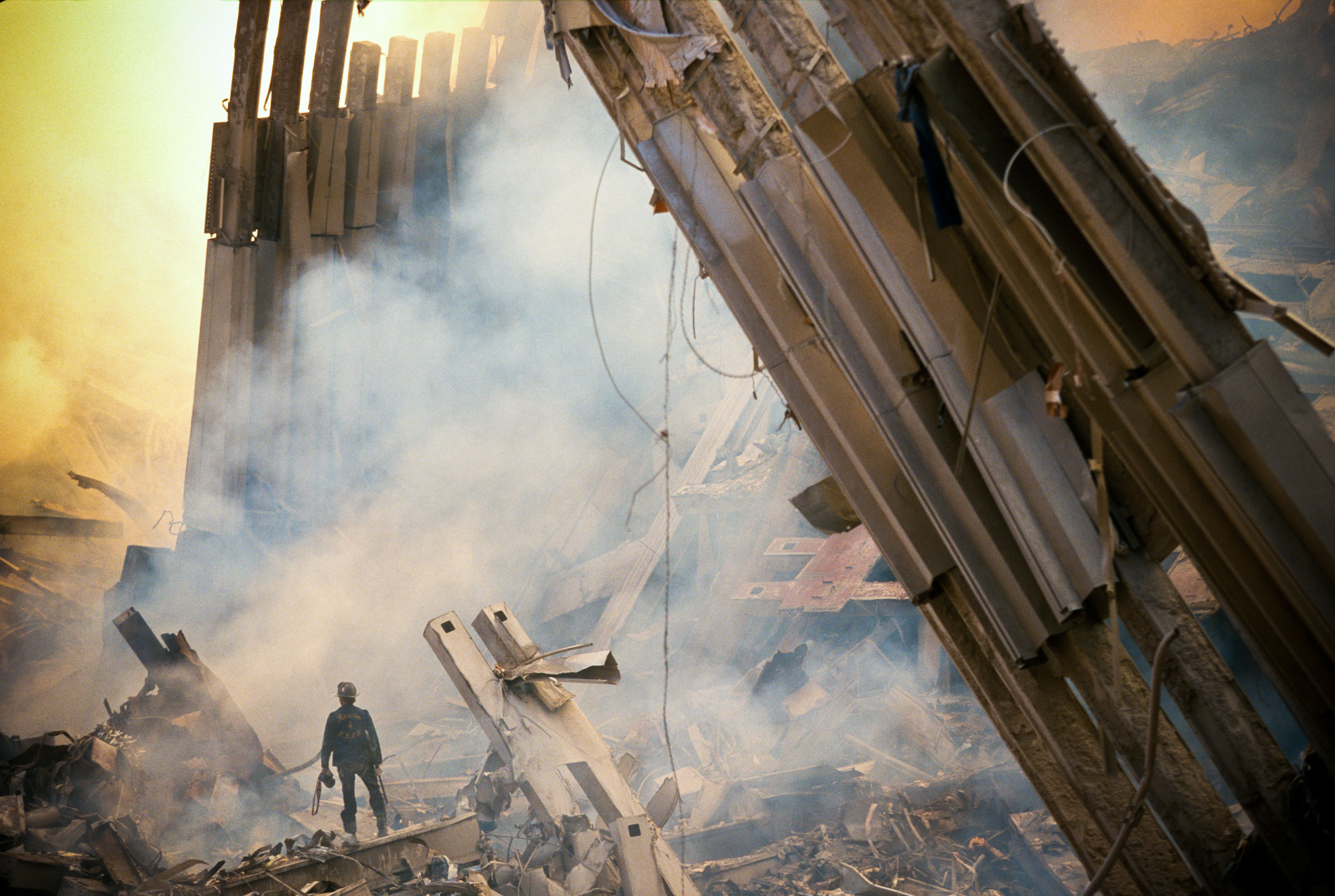 The rubble of the World Trade Center smoulders one day after two hijacked commercial jets hit the twin towers in New York City, causing both to collapse.