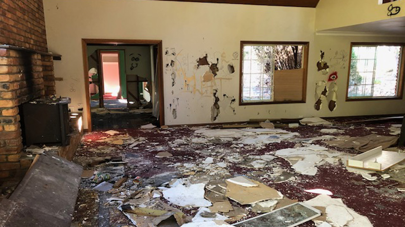 Abandoned luxury home for sale after being destroyed by vandals