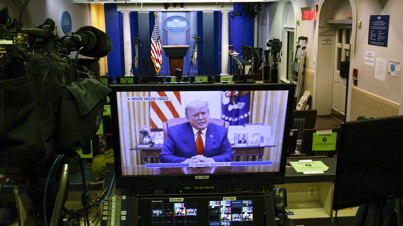 President Donald Trump on a television monitor in an empty press briefing room at the White House in Washington.