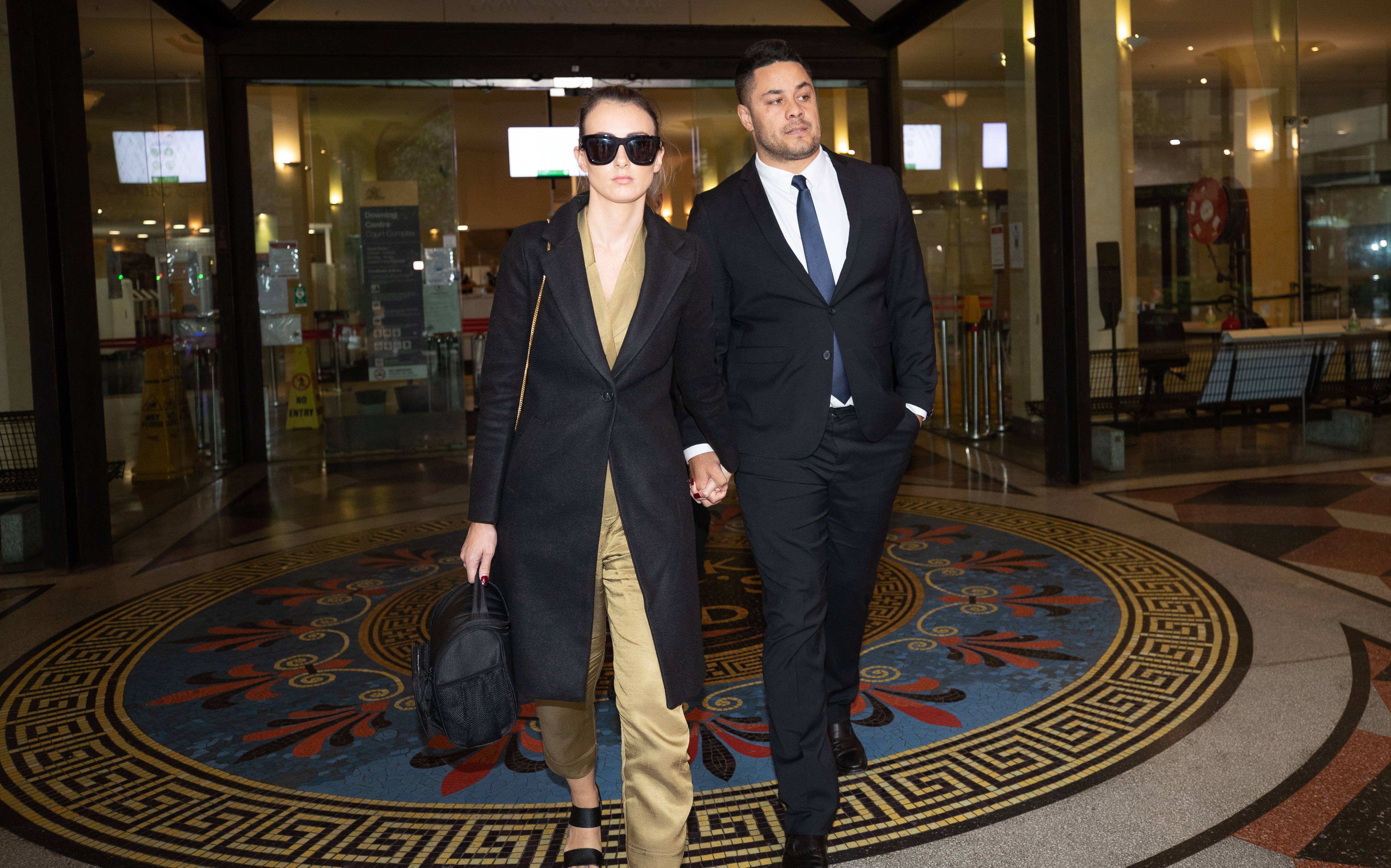 Jarryd Hayne with his wife, walking out of Downing Centre Courts after a guilty verdict.