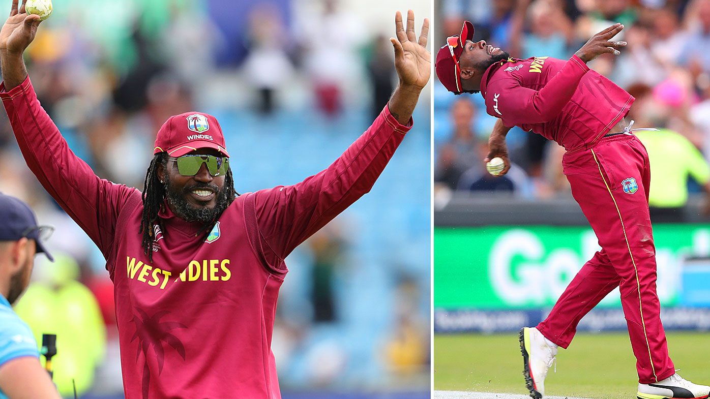 Gayle acknowledges the crowd as Allen celebrates his cracking catch