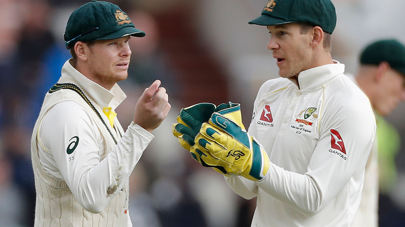 Steve Smith and Tim Paine discuss tactics during the Ashes.