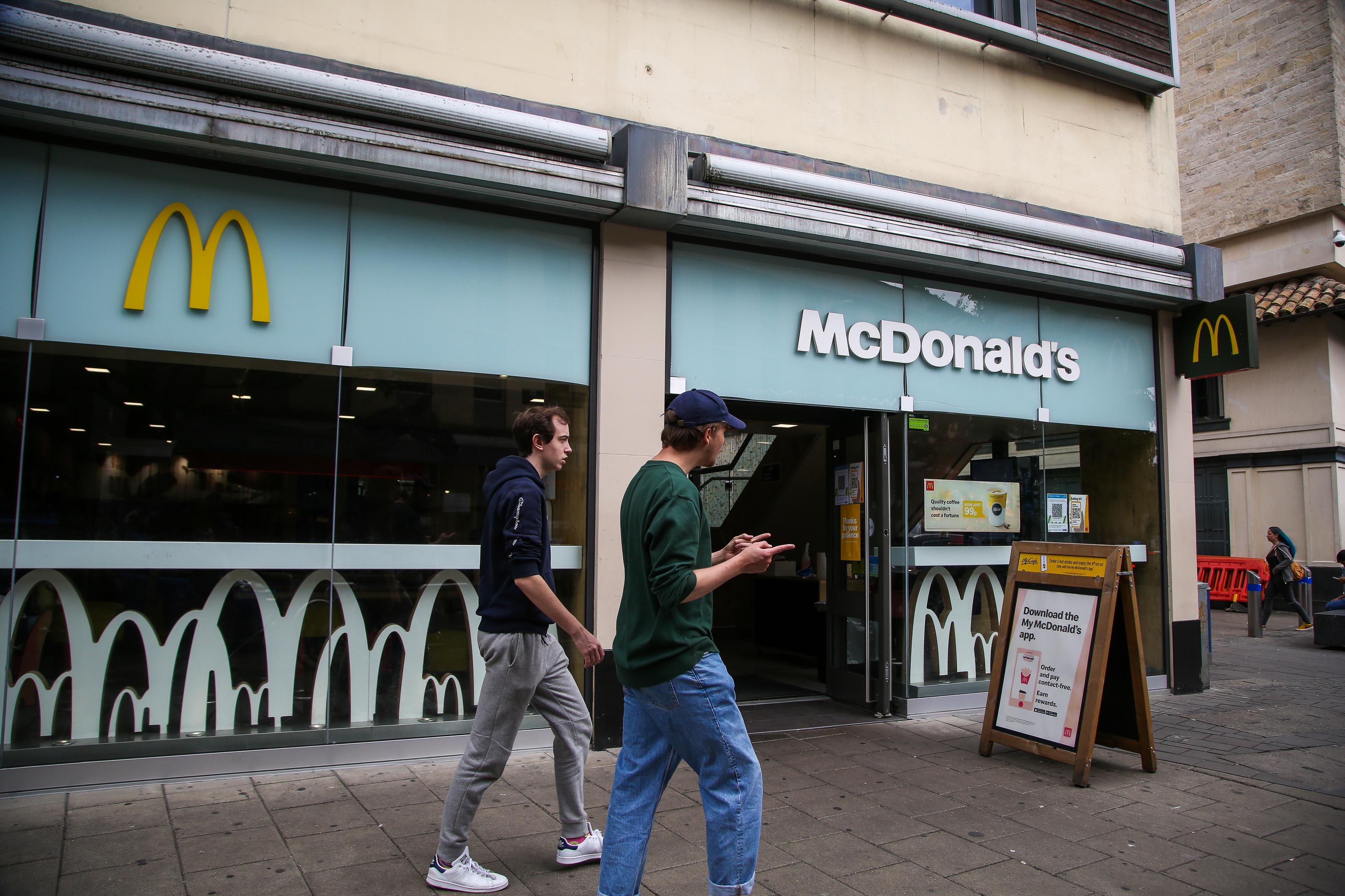 BRISTOL, UNITED KINGDOM - 2021/08/16: Men walk past a branch of McDonald's in Bristol. (Photo by Dinendra Haria/SOPA Images/LightRocket via Getty Images)
