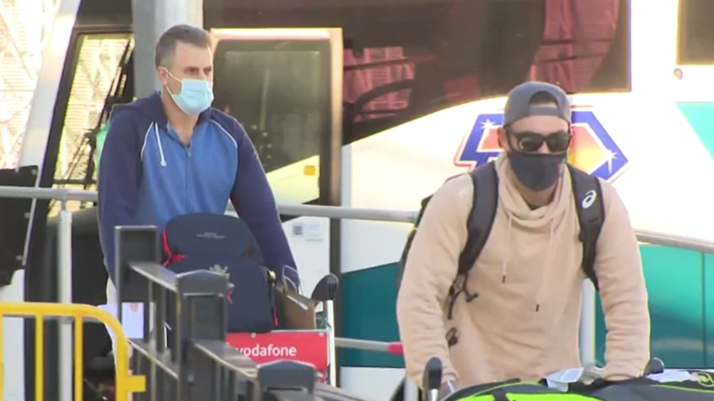 Aussie cricketers exit Sydney airport, bound for quarantine after leaving India.