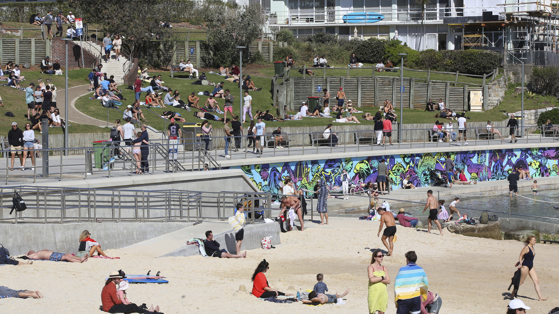 Crowds take in fine weather at Bondi Beach.