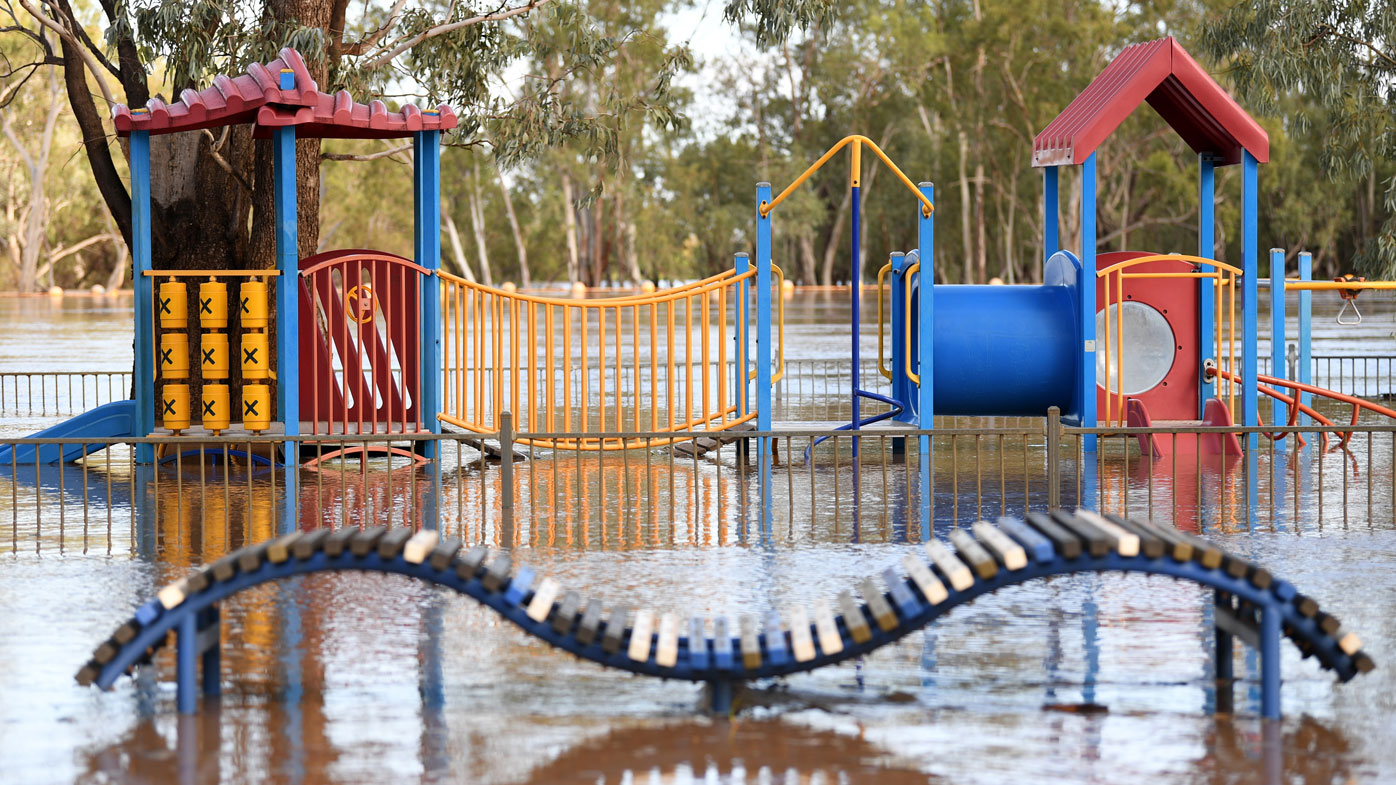 A playground is surrounded by flood water in St George, south-western Queensland, Wednesday, February 26, 2020. The Balonne river is expected to break its banks and peak over 12 metres on Thursday, causing floods