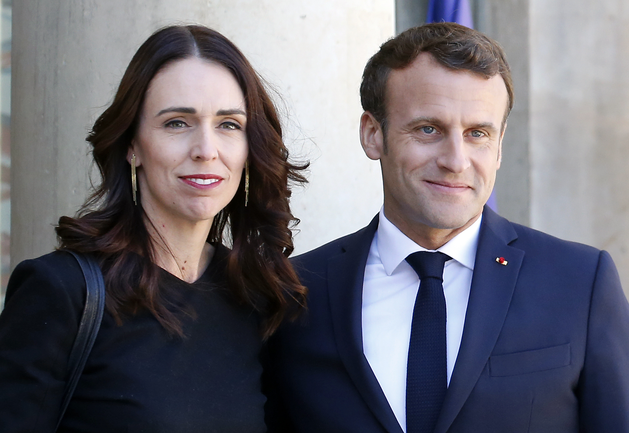 French President Emmanuel Macron welcomes New Zealand Prime Minister Jacinda Ardern prior to their meeting at Elysee Palace on May 15, 2019 in Paris, France.