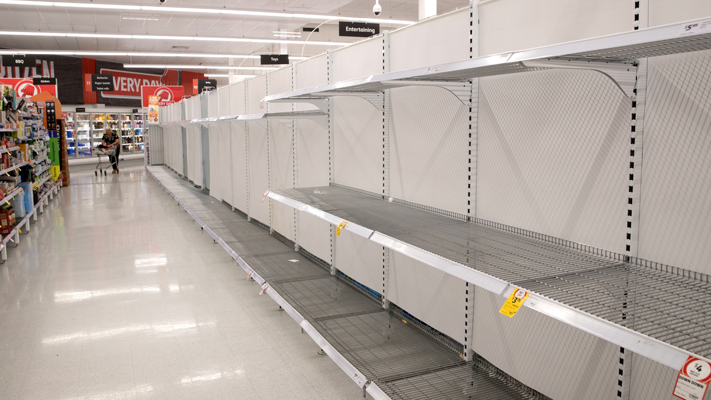 Empty toilet paper shelves in a Coles store in Sydney. Some customers have stockpiled toilet rolls and other essential items.