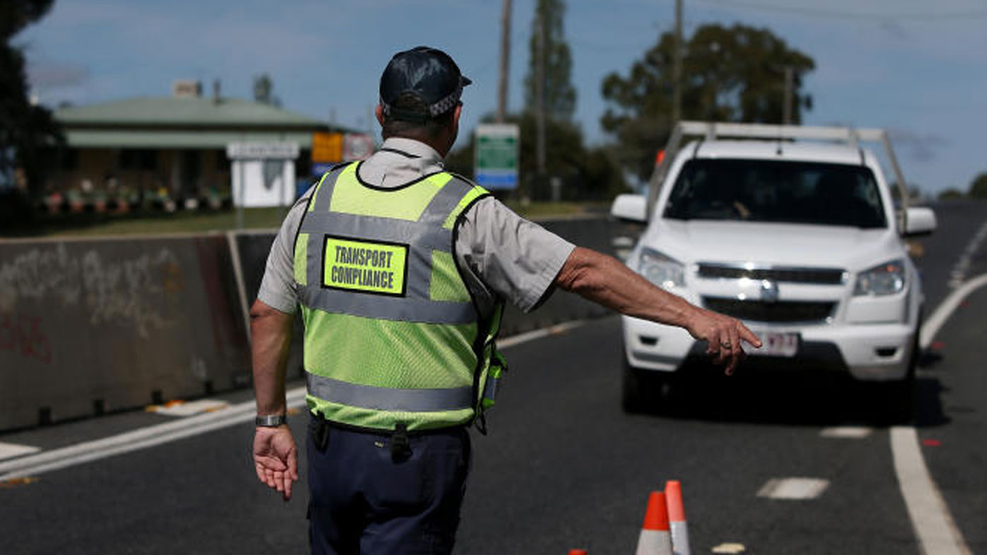 Queensland increases border checks as South Australia's ban comes in