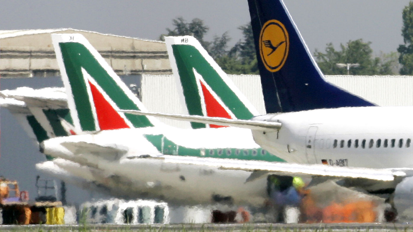 Lufthansa and Alitalia jetliners are parked at the Milan Linate airport, Italy.