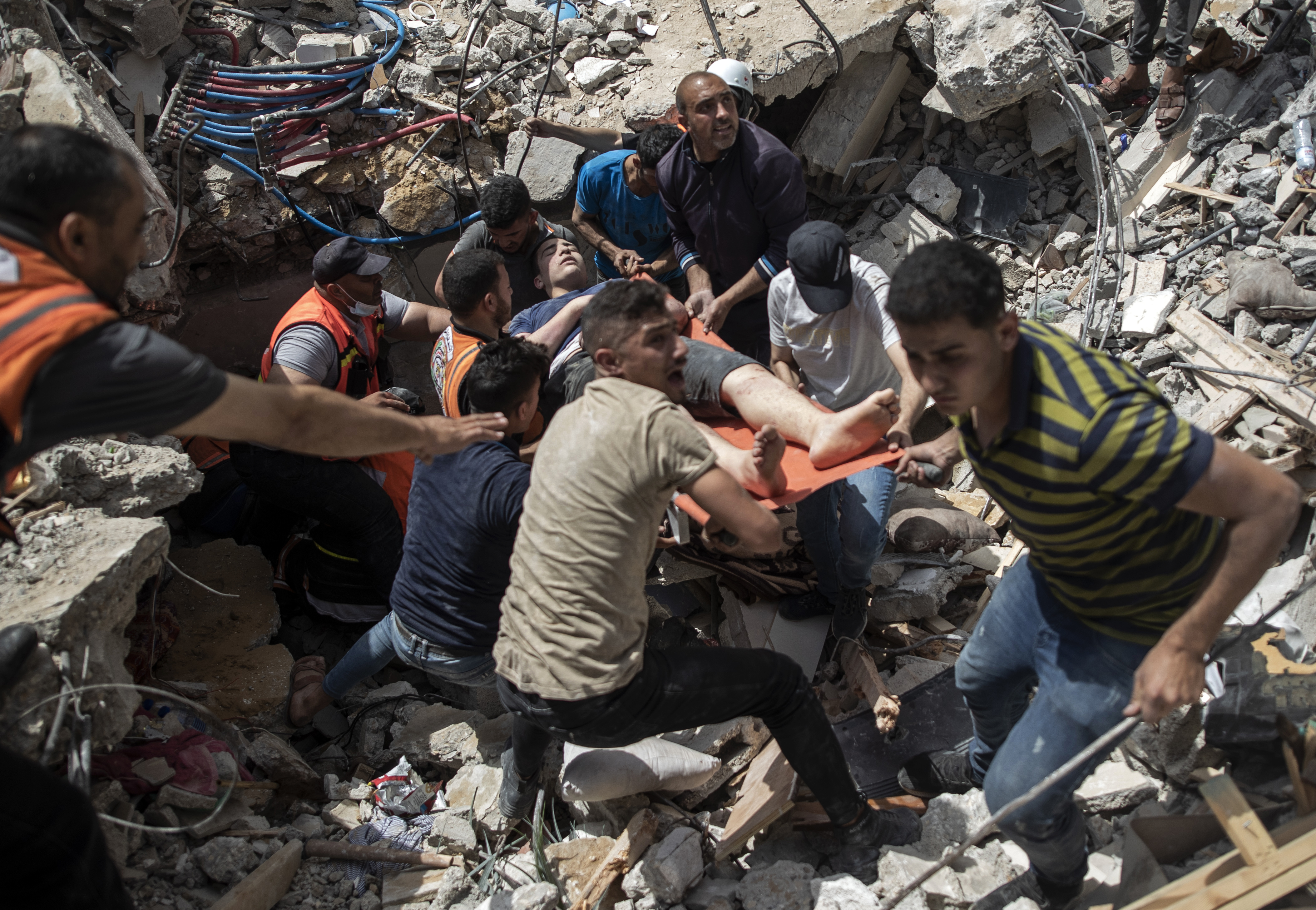 Strike from Gaza kills two as Israel topples six-storey building