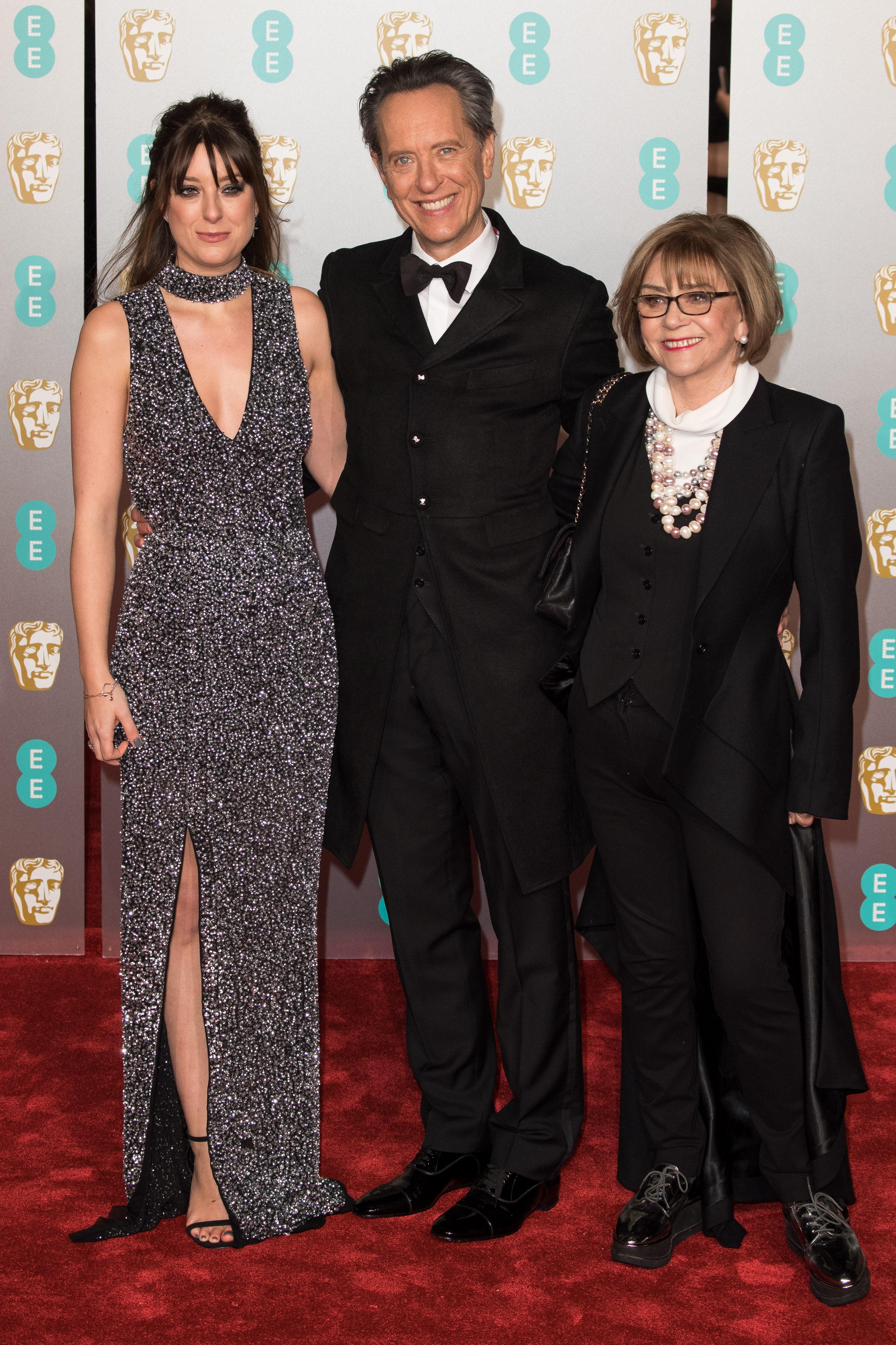 Richard E. Grant with daughter Olivia (left) and wife Joan Washington attend the EE British Academy Film Awards at Royal Albert Hall on February 10, 2019 in London, England.