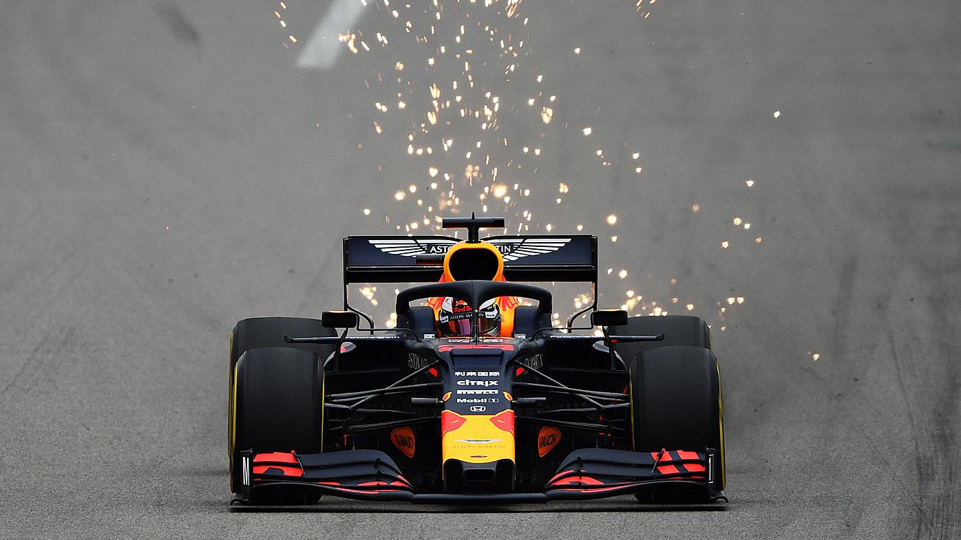 Sparks fly behind Verstappen's car