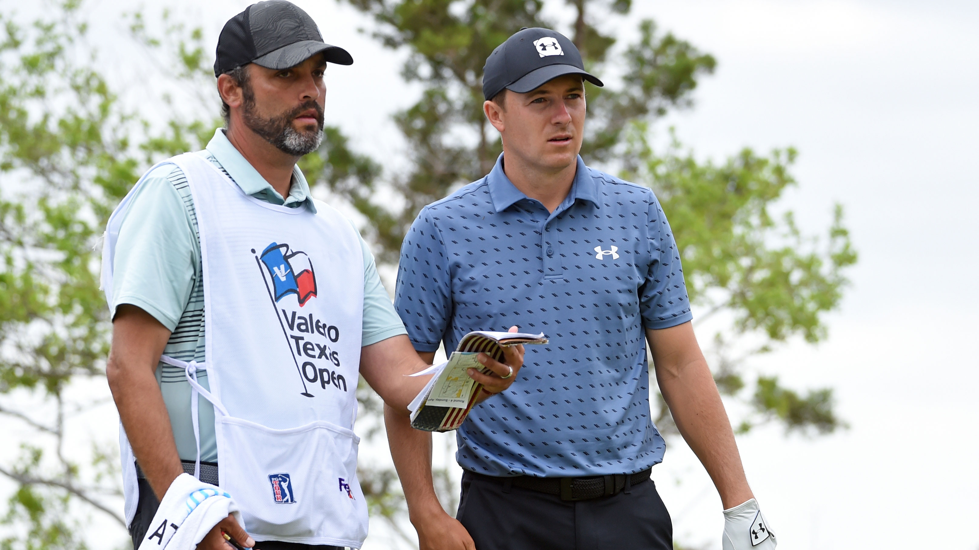 Jordan Spieth consults his caddie during the final round of the Texas Open.
