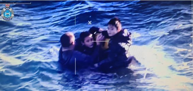 A man and two boys have been rescued from a sinking boat in waters off Western Australia.