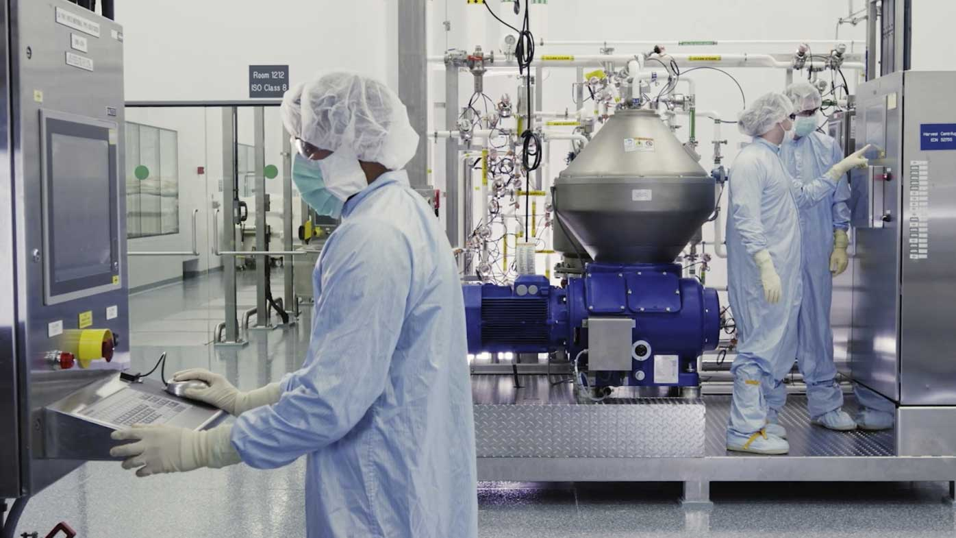 Scientists work with a bioreactor at a Regeneron facility in New York state, for efforts on an experimental coronavirus antibody drug.