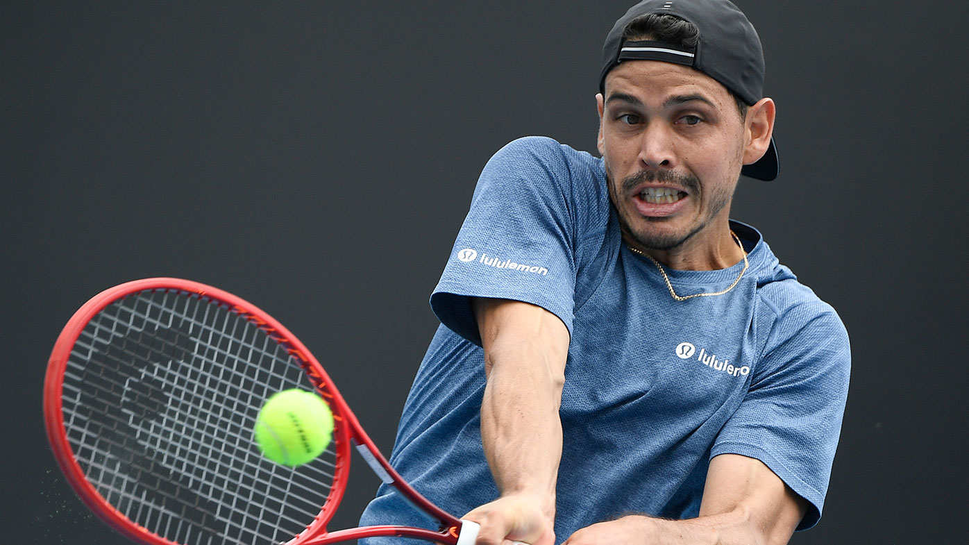 Australia's Alex Bolt makes a forehand return to Slovakia's Norbert Gombos during their first round match at the Australian Open tennis championship in Melbourne, Australia, Monday, Feb. 8, 2021.(AP Photo/Andy Brownbill)
