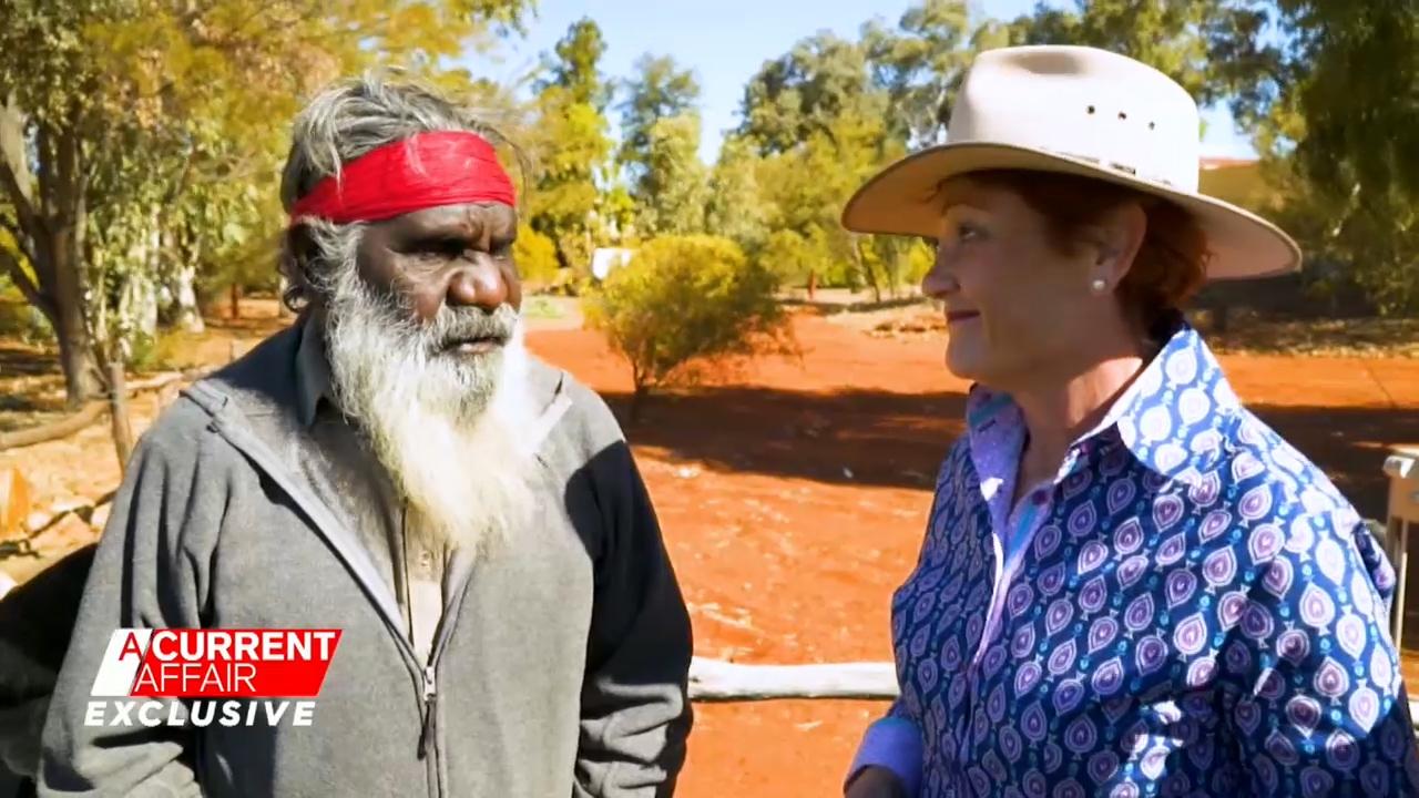 Pauline Hanson climbs Uluru