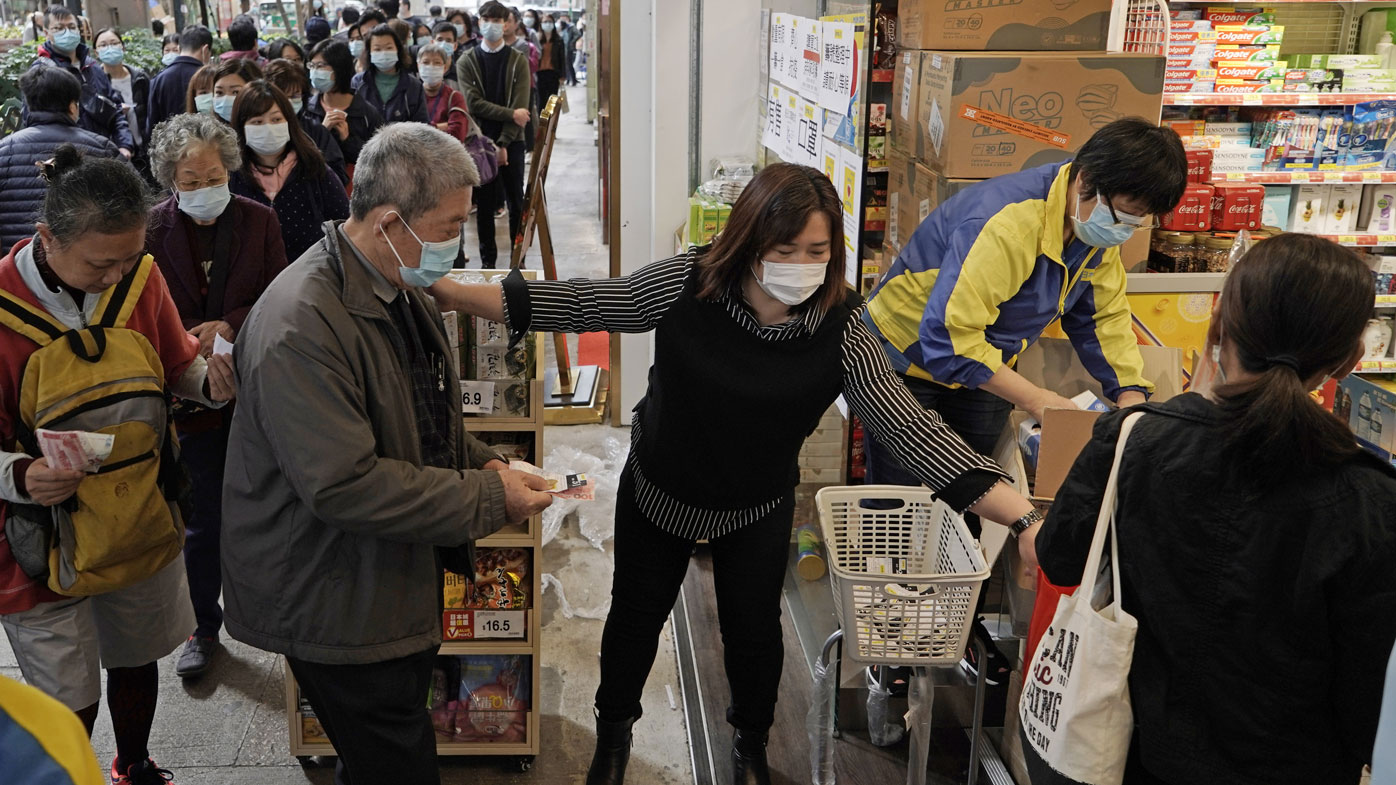 People queue up to buy face masks in Hong Kong, Friday, Feb. 7, 2020