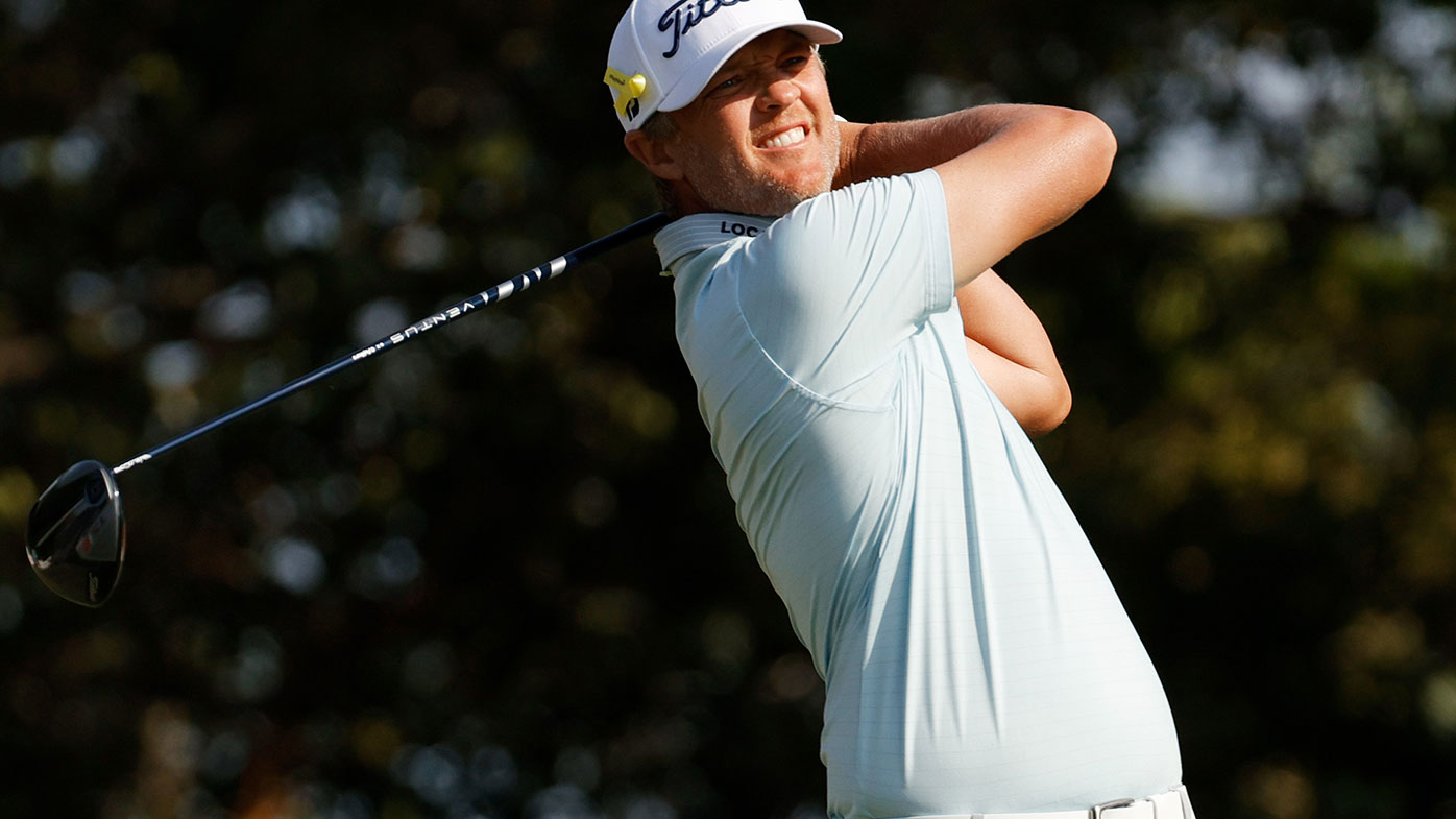 Matt Jones of Australia plays his shot from the 14th tee during the final round of The Honda Classic.
