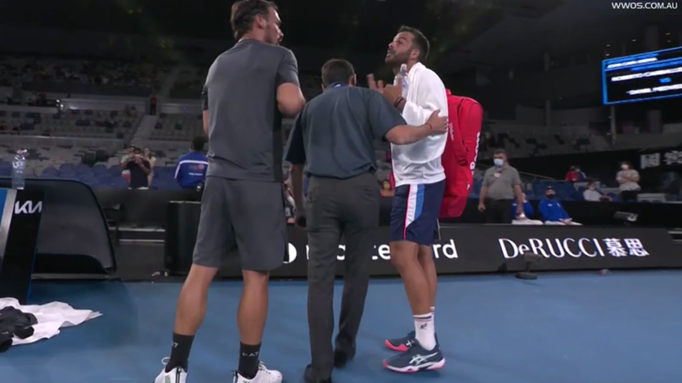 Fognini and Caruso get stuck in. (Nine)