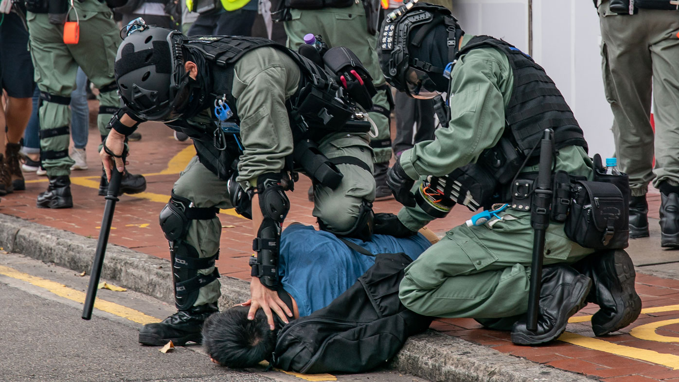 Hong Kong police fire tear gas as protests resume