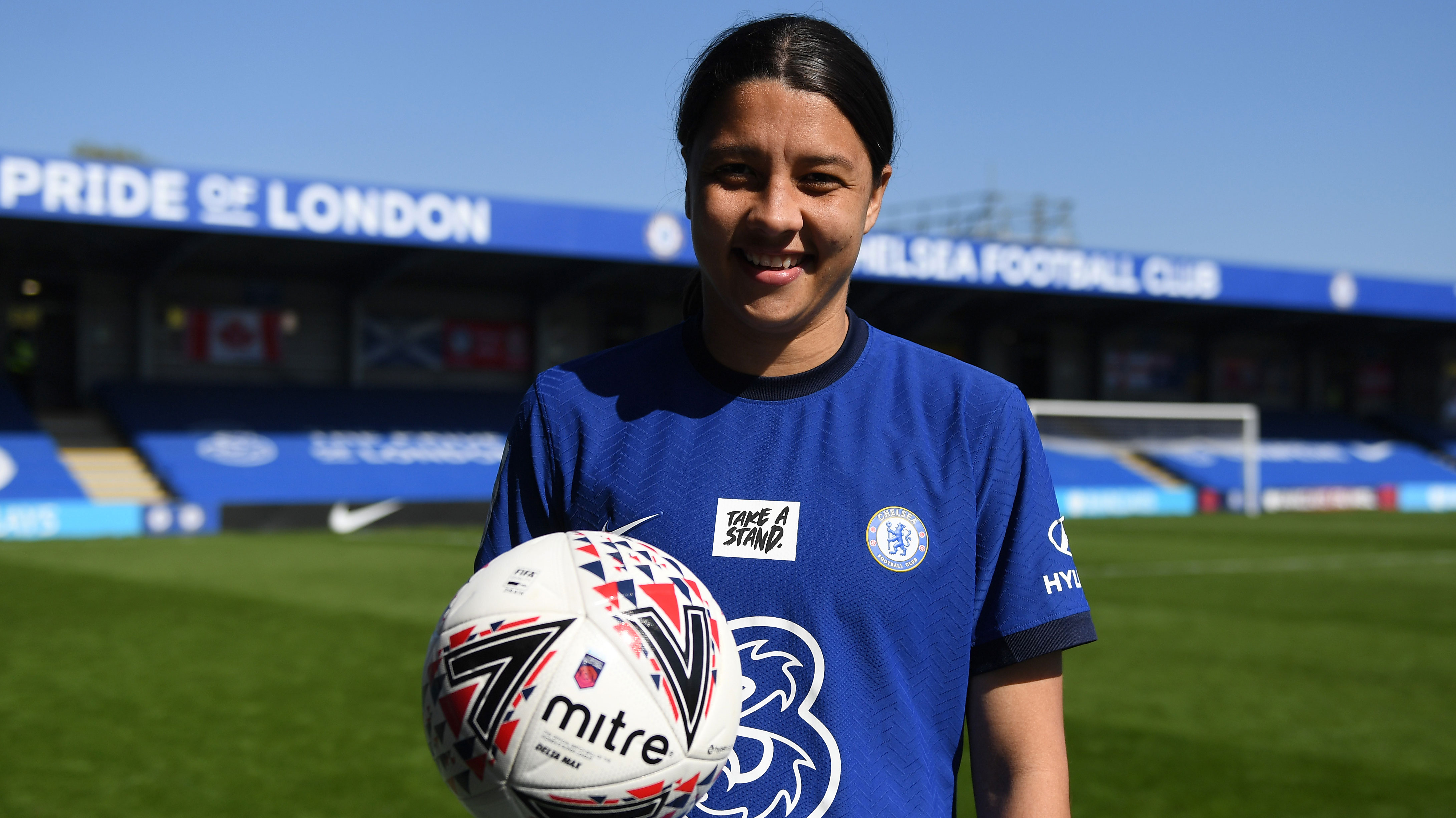 Sam Kerr poses with the match ball after scoring a hat-trick against Birmingham City.