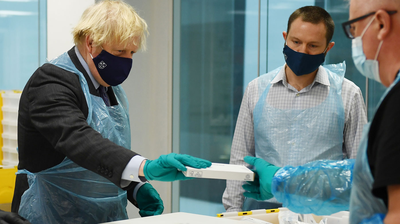 British Prime Minister Boris Johnson is shown the Lighthouse Laboratory used for processing PCR samples, during a visit to the Queen Elizabeth University Hospital campus on January 28, 2021 in Glasgow, United Kingdom