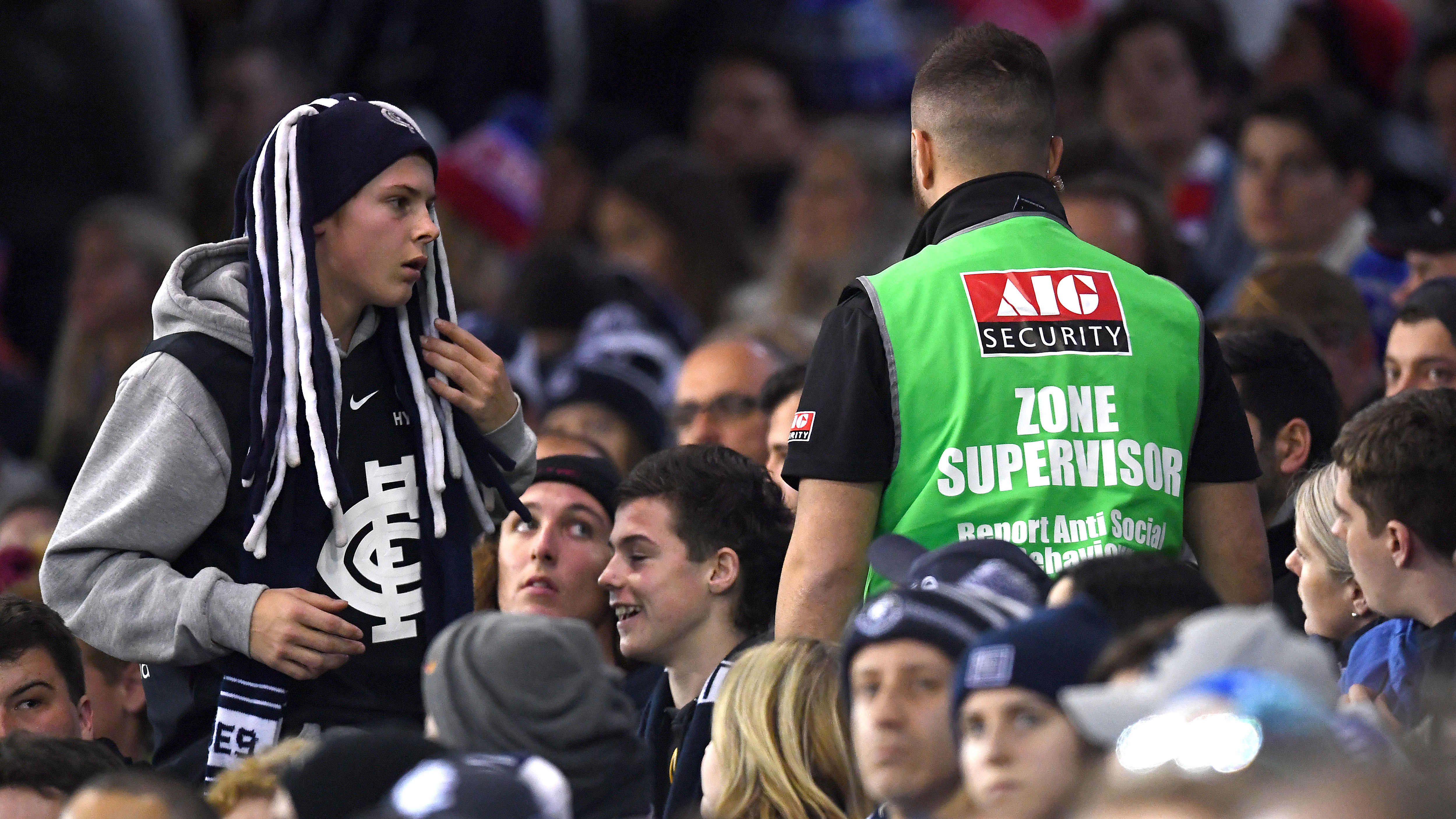 A crowd control officer patrols the stadium.