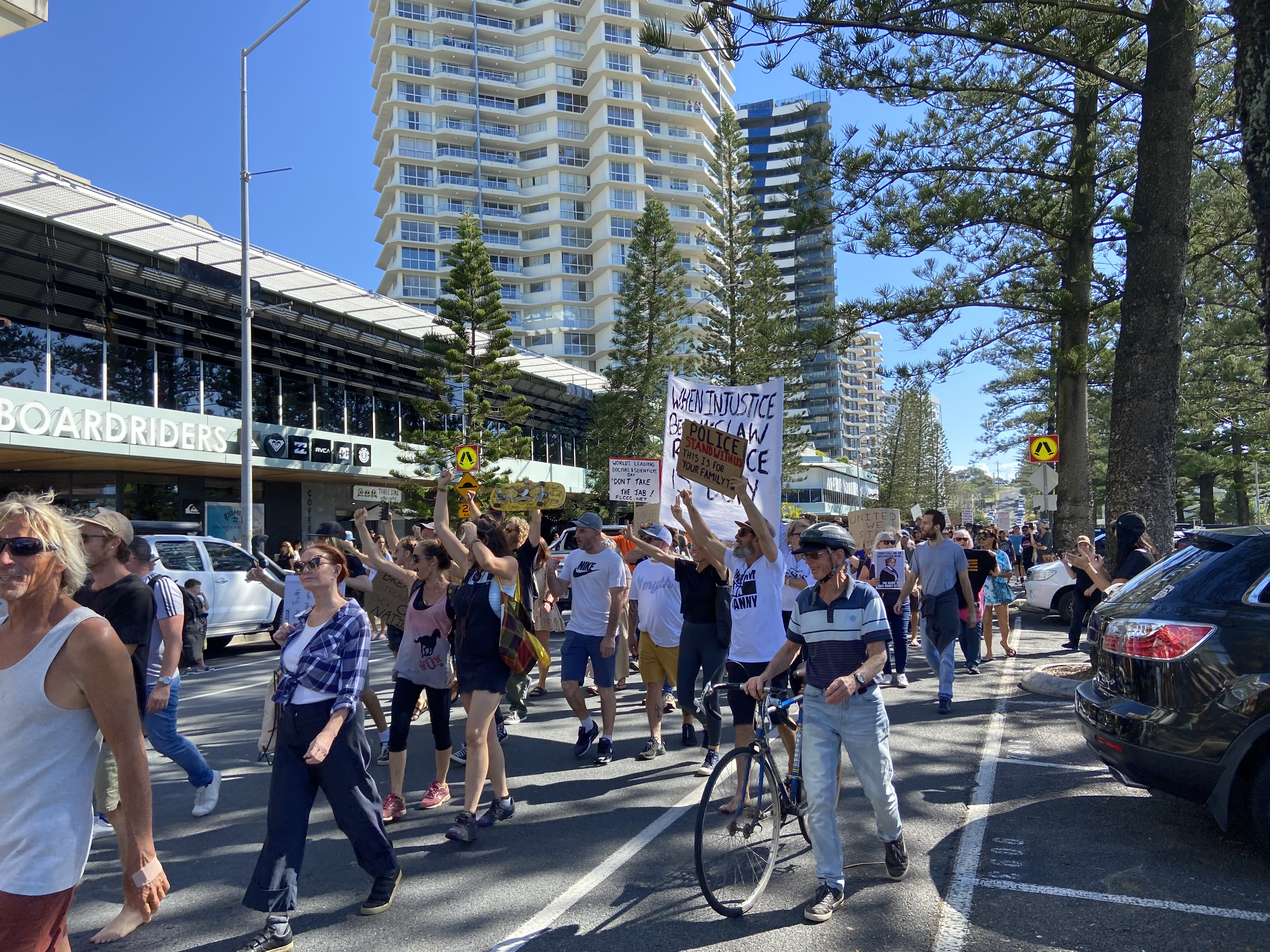 People gathered on Coolangatta Esplanade protesting an end to vaccinations and lockdown.