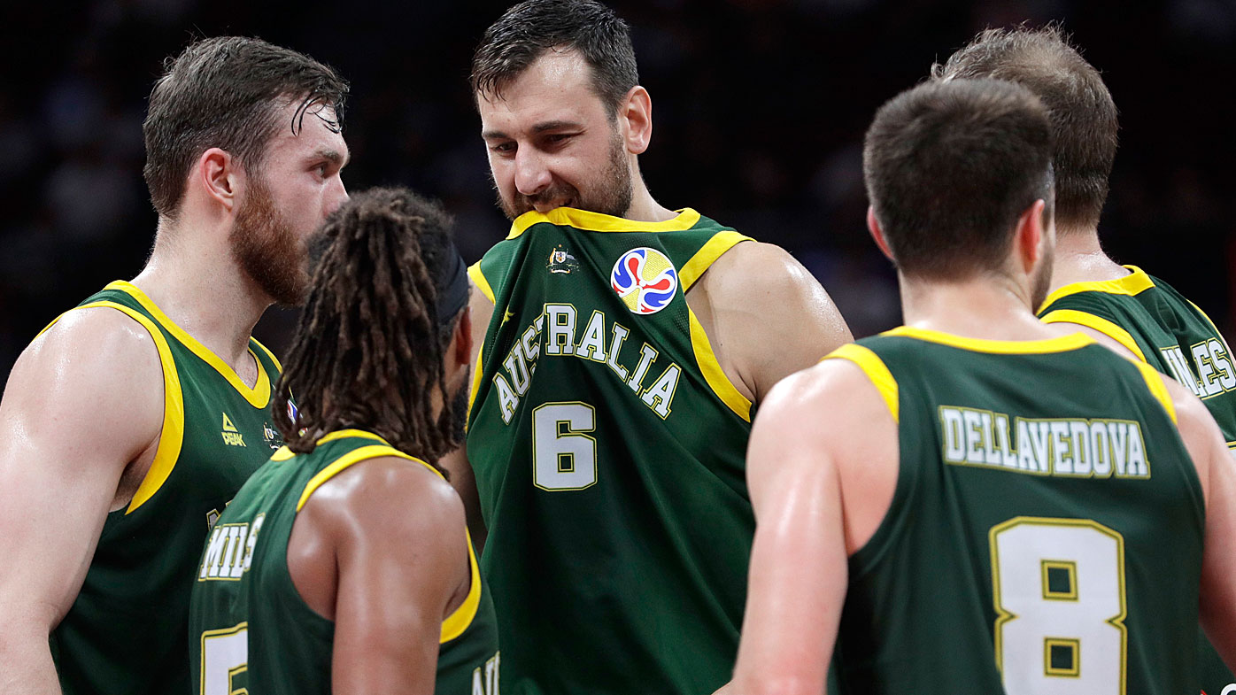 Andrew Bogut of Australia, center, reacts during their semifinal