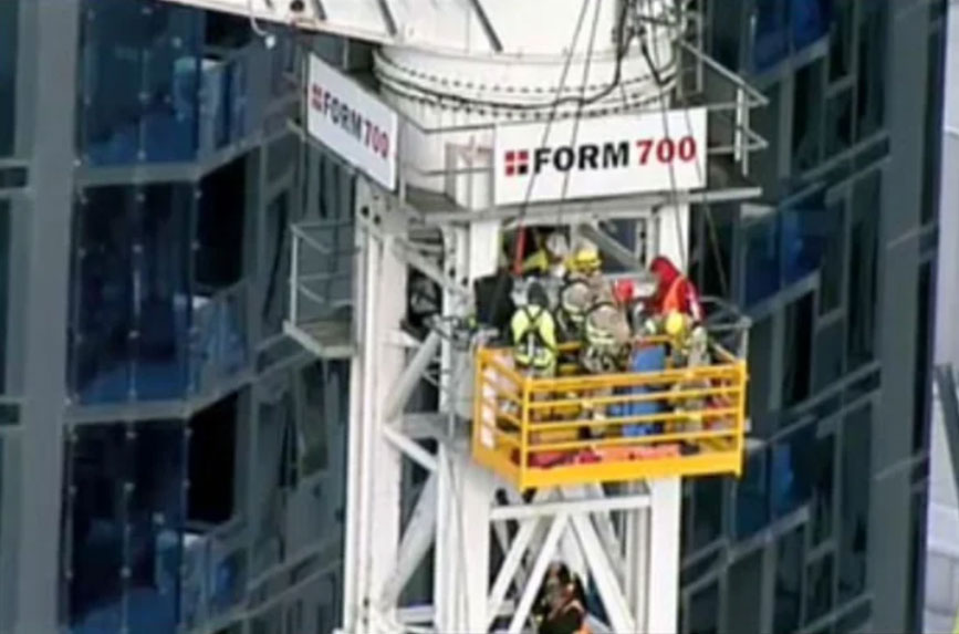 Injured crane worker rescued at high-rise building site