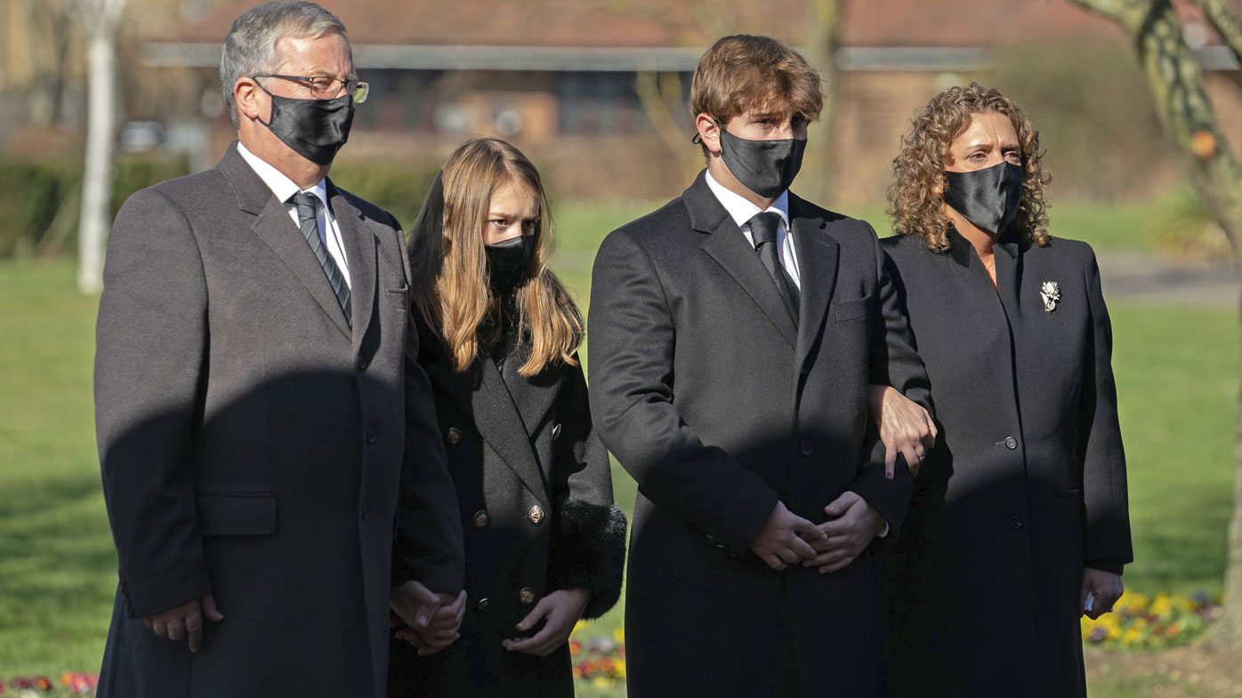 The family of Captain Tom Moore, from left, son-in-law Colin Ingram, granddaughter Georgia, grandson Benjie and daughter Hannah Ingram-Moore arrive for his funeral, at Bedford Crematorium, in Bedford, England, Saturday, Feb. 27, 2021.