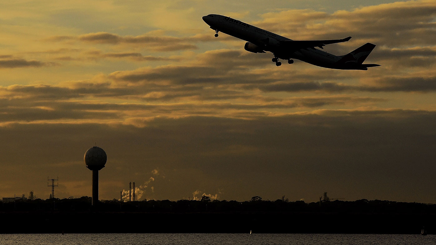 A plane takes off from Sydney airport.