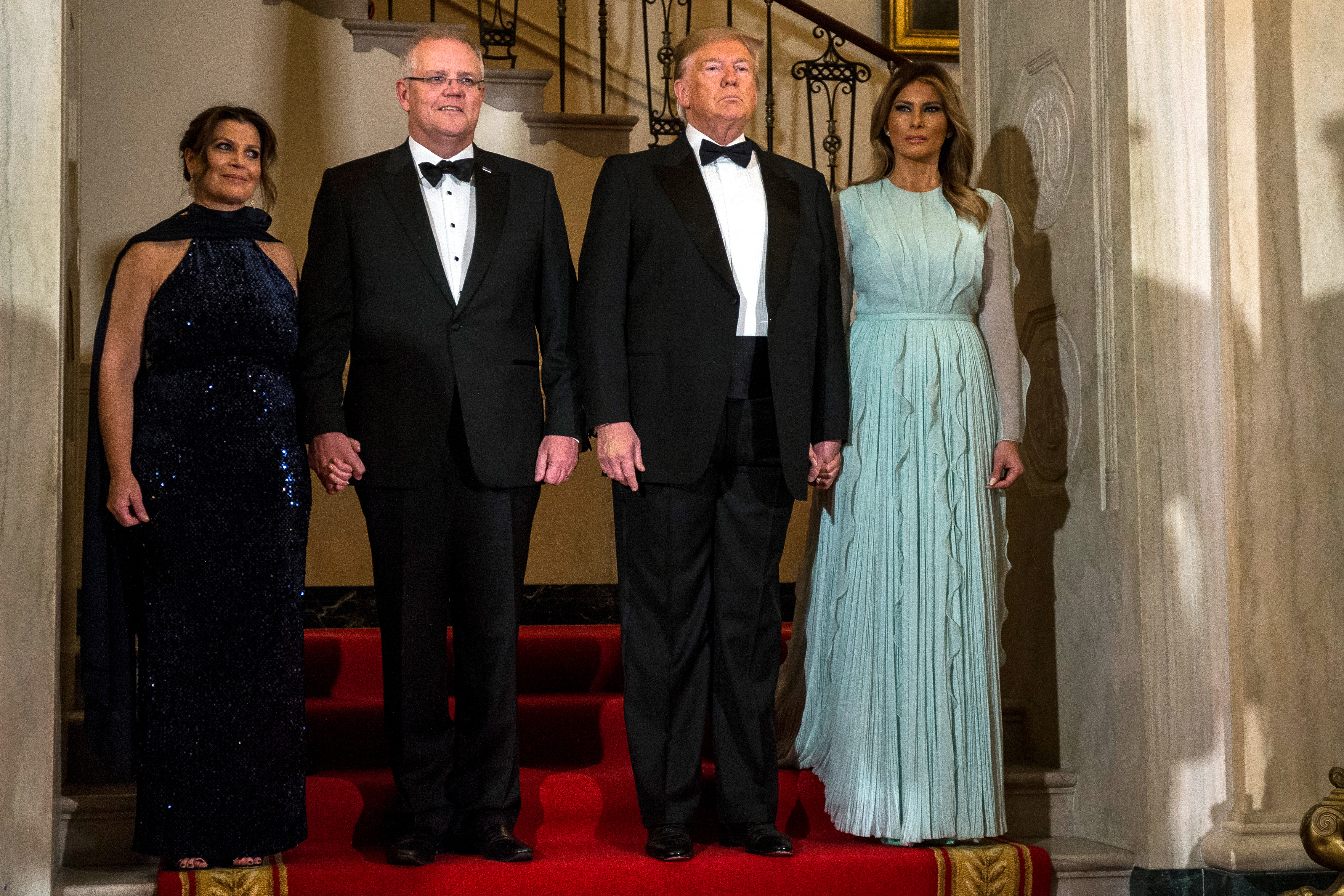 US President Donald Trump and First Lady Melania Trump, Australian Prime Minister Scott Morrison, and Australian First Lady Jennifer Morrison are pictured ahead of a state dinner at the White House September 20, 2019 in Washington, DC.