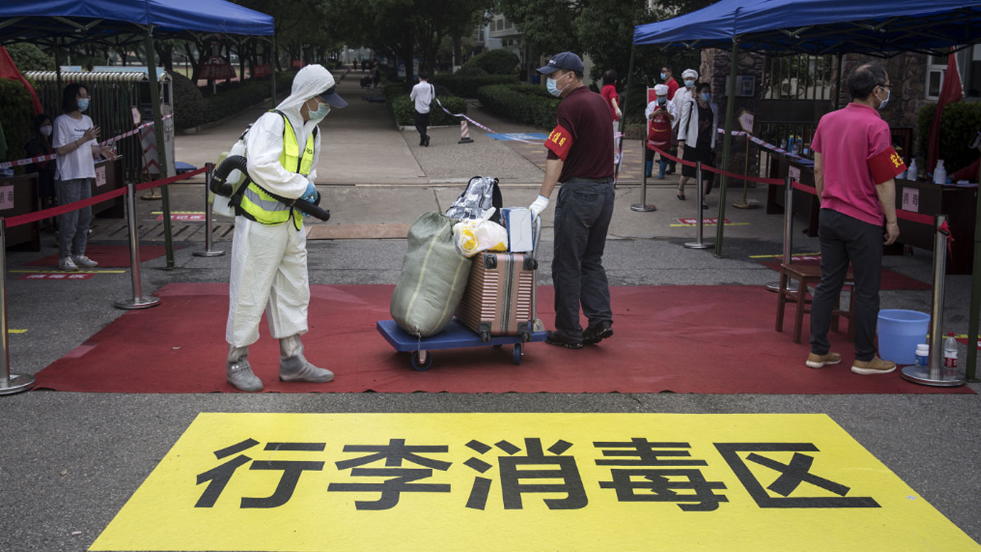 China's top diplomat urges US to cooperate over pandemic