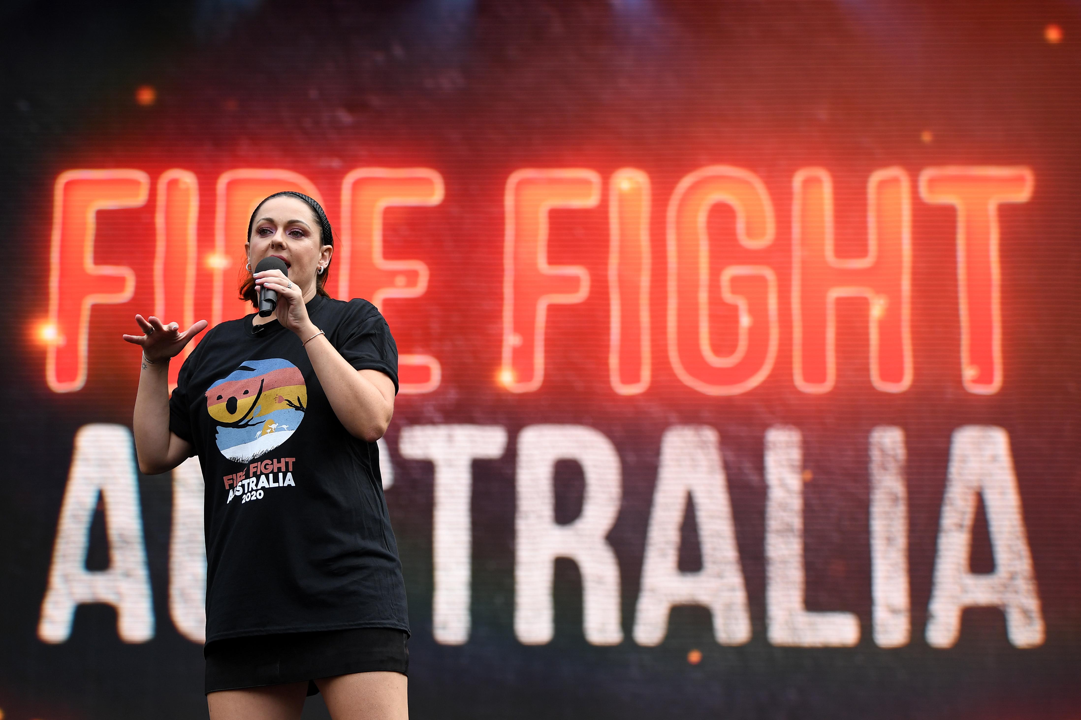 Celeste Barber speaks during the Fire Fight Australia bushfire relief concert at ANZ Stadium in Sydney, Sunday, February 16, 2020. (AAP Image/Joel Carrett)