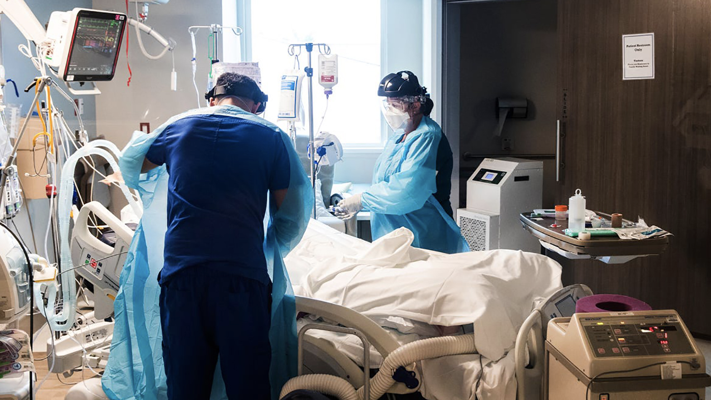 A respiratory therapist treats a COVID-19 patient in a NCH Healthcare System's ICU on August 9 in Naples, Florida. (Andrew West/Fort Meyers News-Press/USA Today Network)