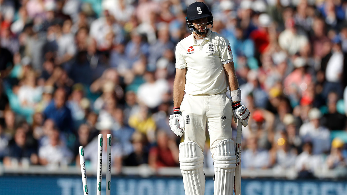 Joe Root looks at the wicket after being skittled by Pat Cummins