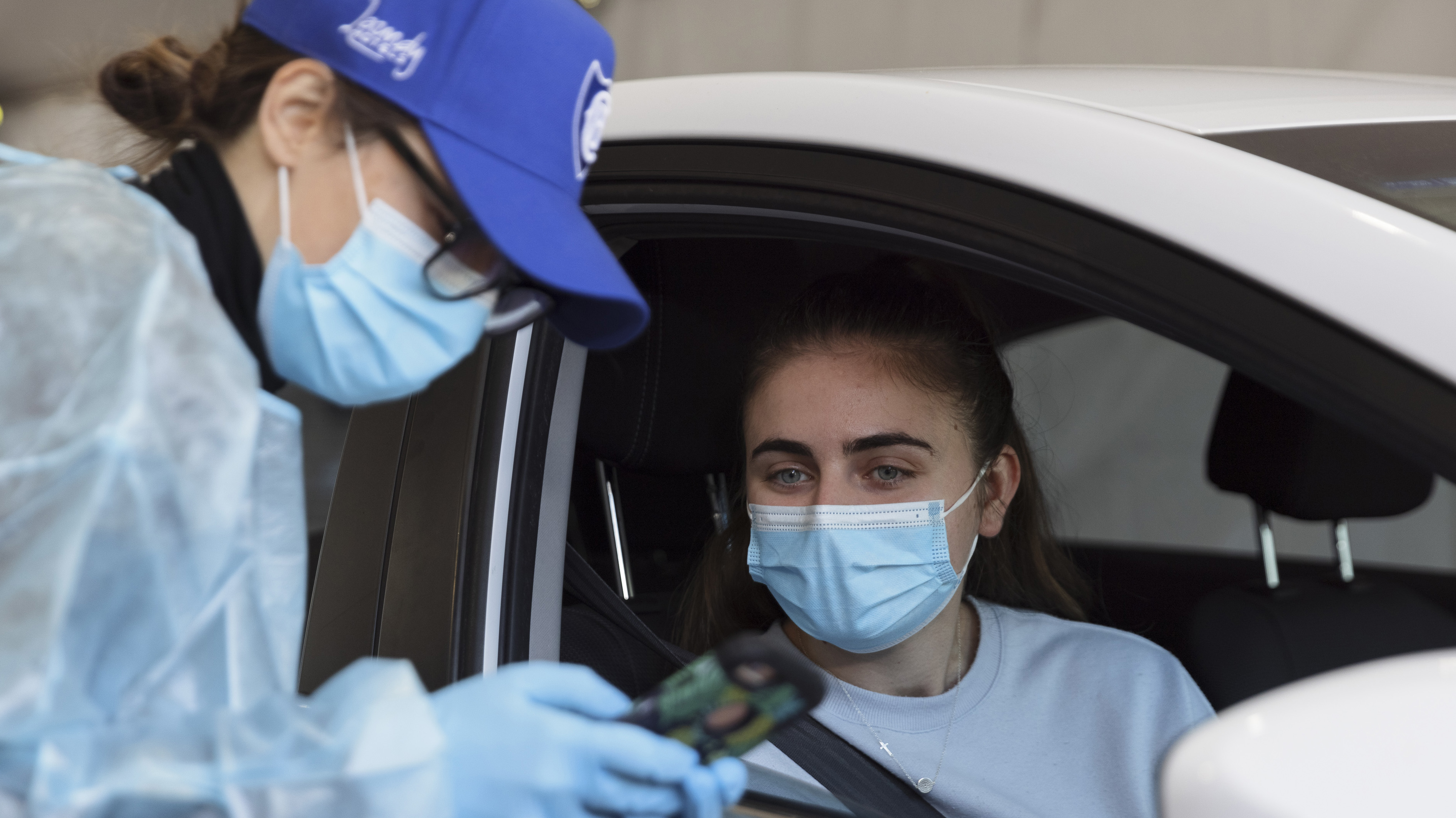 A patient arrives to receive a COVID-19 vaccine at a new drive-through vaccination clinic  in Sydney.