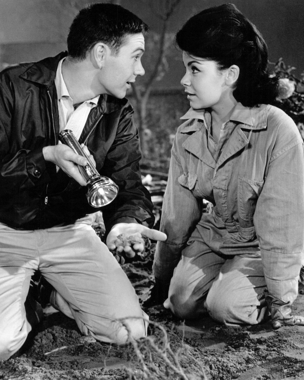 Tommy Kirk, as Merlin Jones, and Annette Funicello (1942 - 2013), as Jennifer, in a publicity still for 'The Misadventures Of Merlin Jones', directed by Robert Stevenson, 1964.