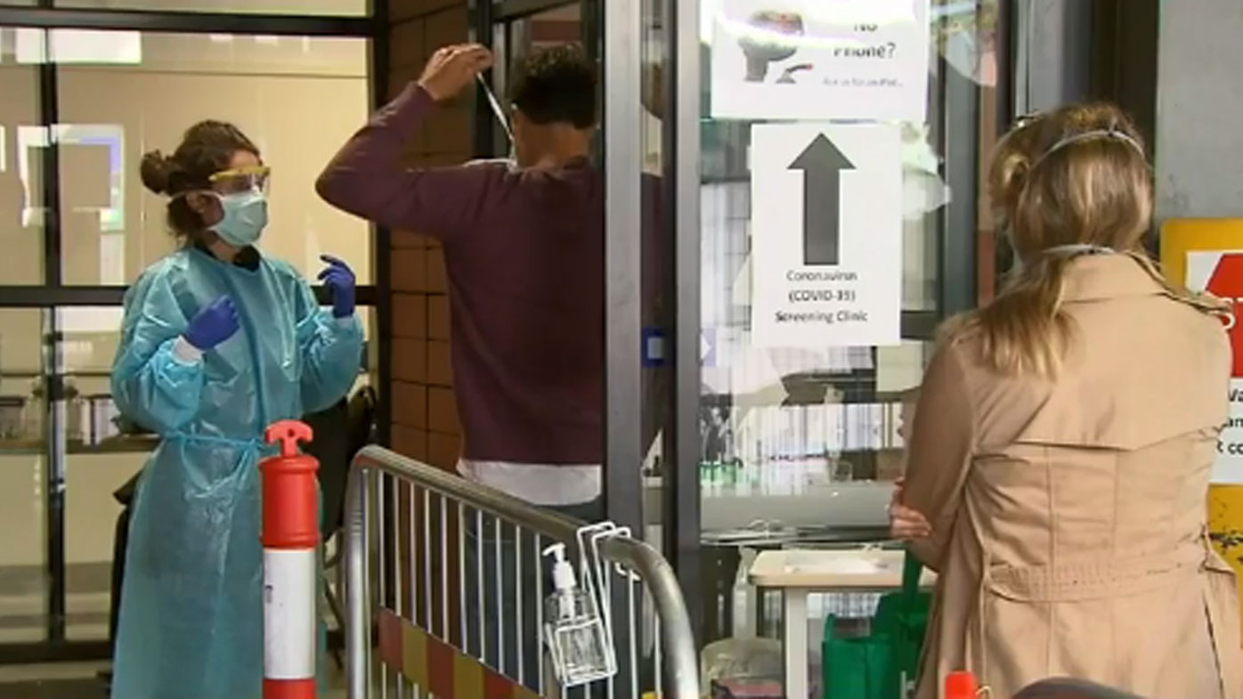 Woman 'spat at hospital staff'