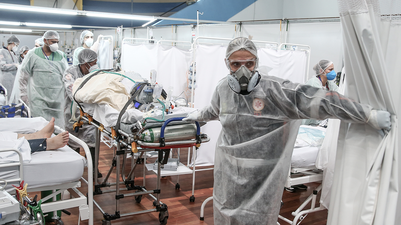 Medical staff members transport a patient on a stretcher at the Pedro DellAntonia Sports Complex field hospital as coronavirus cases soar on March 11, in Santo Andre, Brazil. (Alexandre Schneider/Getty Images South America/Getty Images)